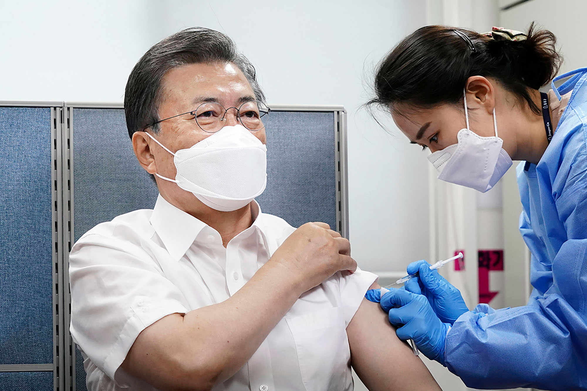 In this image provided by the South Korean Presidential Blue House, President Moon Jae-in receives a dose of the AstraZeneca Covid-19 vaccine in Seoul on March 23.