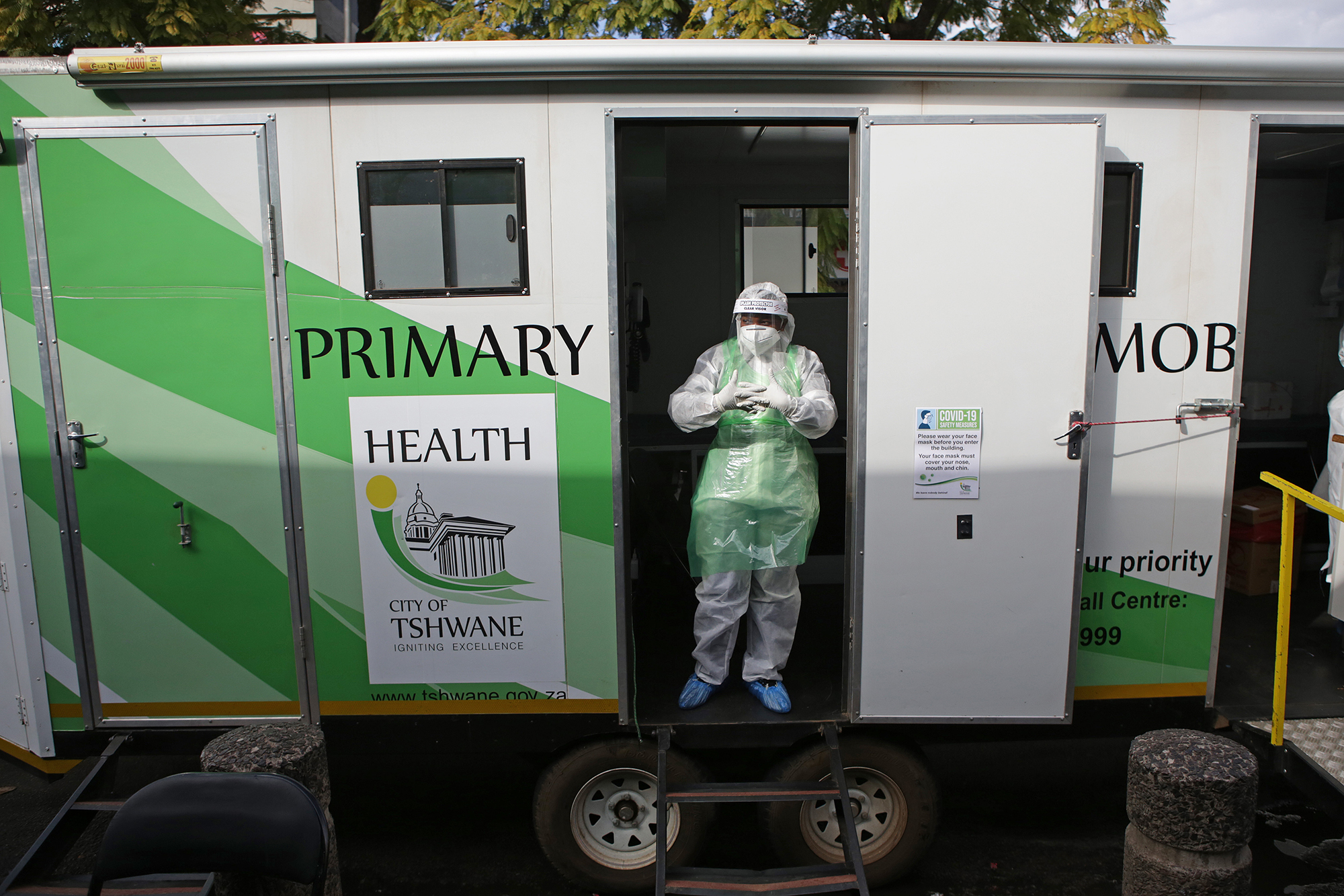 A City of Tshwane Health official stands at the mobile testing unit while waiting to conduct tests for the COVID-19 coronavirus at the Bloed Street Mall in Pretoria Central Business District, on June 11, 2020.