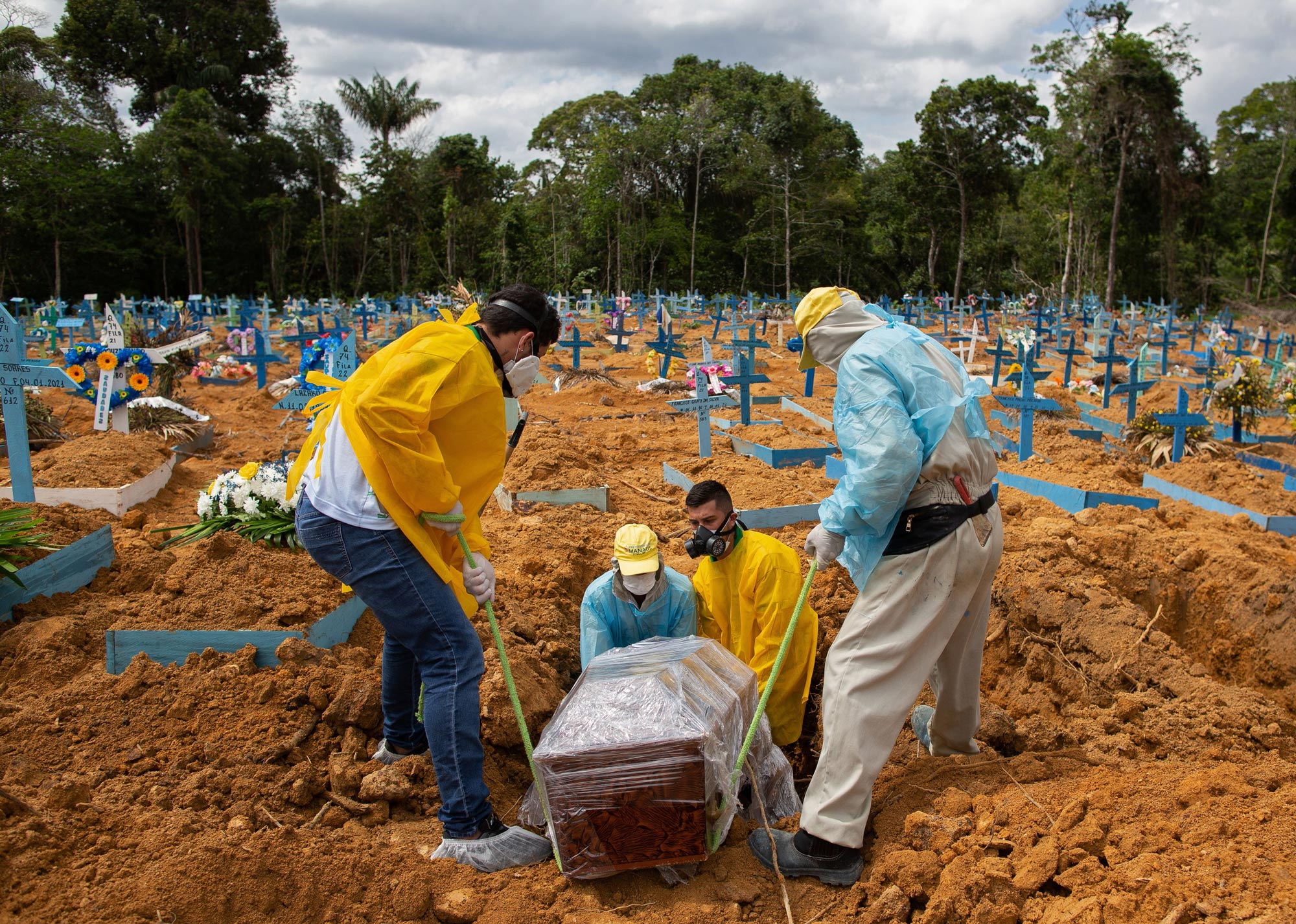 A burial takes place in an area reserved for COVID-19 victims at the Nossa Senhora Aparecida cemetery in Manaus, Brazil, on January 5.