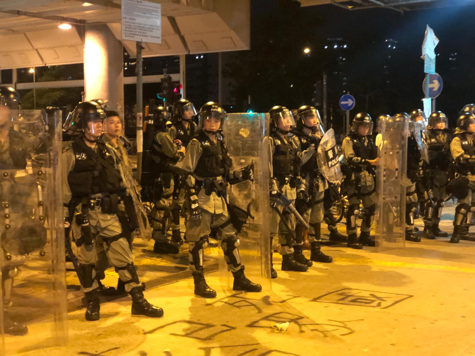 Riot police clash with protesters as Hong Kong march