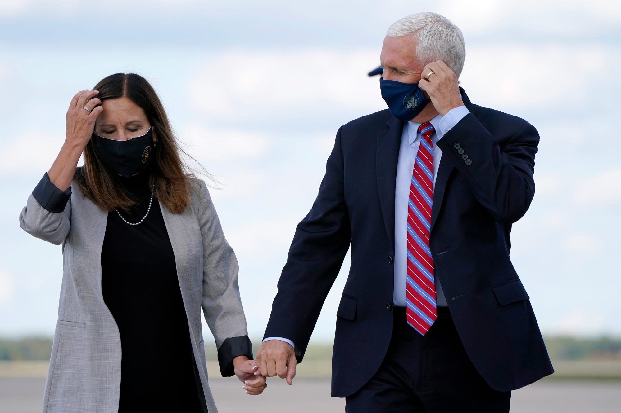 Vice President Mike Pence holds hands with Karen Pence at Andrews Air Force Base, Maryland, on October 5.