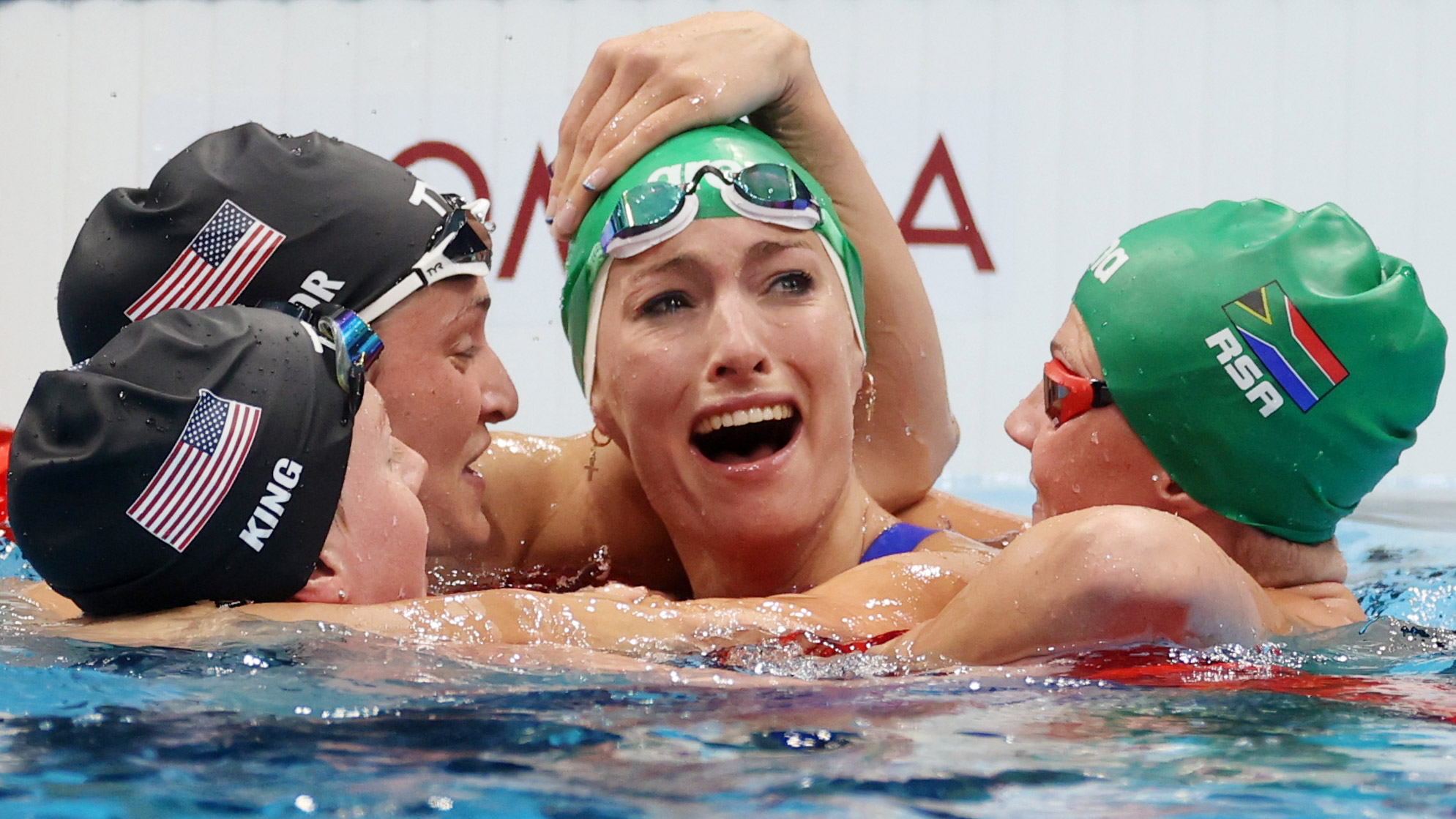 Tatjana Schoenmaker of South Africa celebrates with Lilly King and Annie Lazor of the United States and her teammate Kaylene Corbett after setting a new world record and winning gold in the 200-meter breaststroke on Friday.