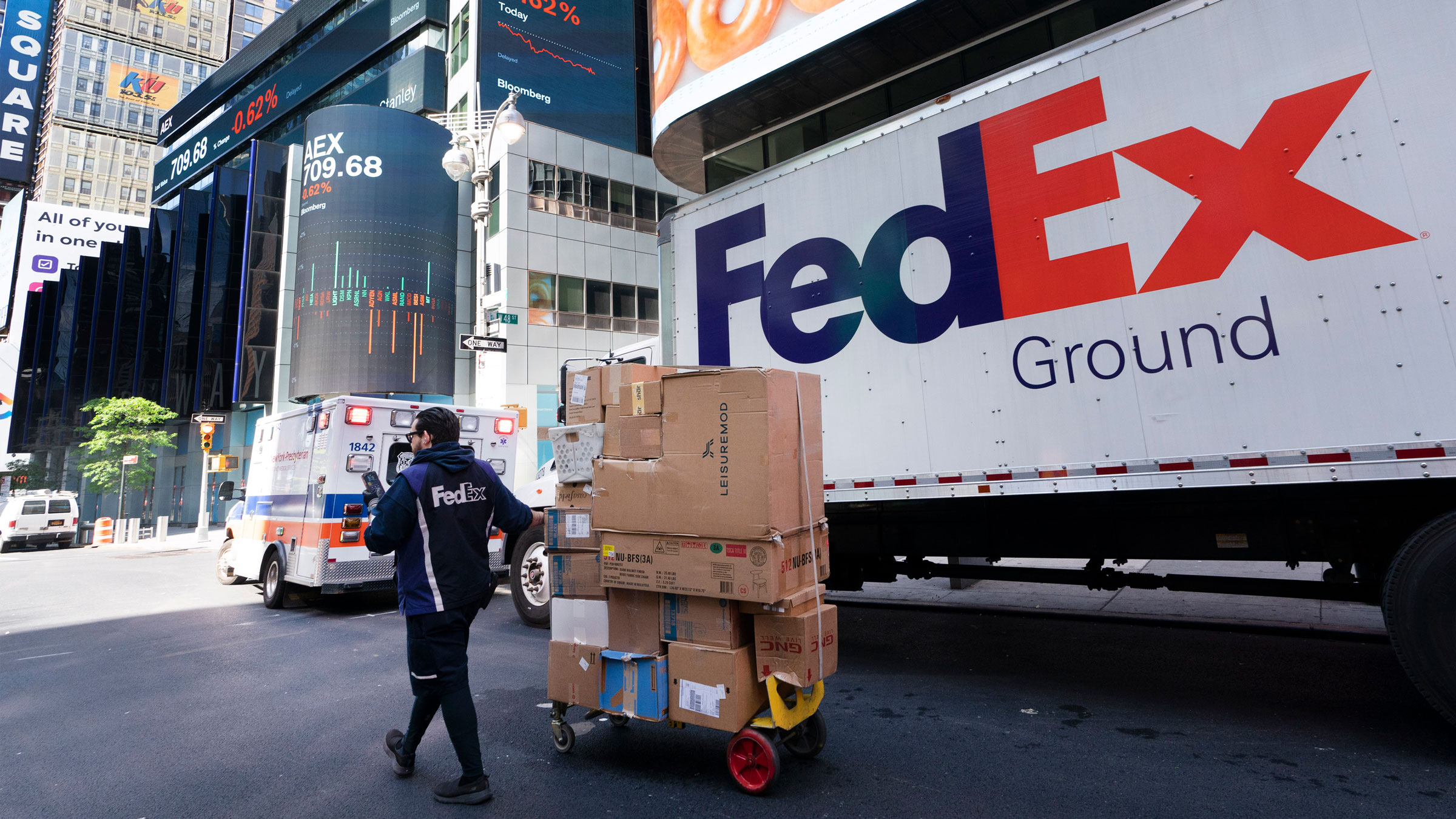 A FedEx driver delivers packages in New York in May.