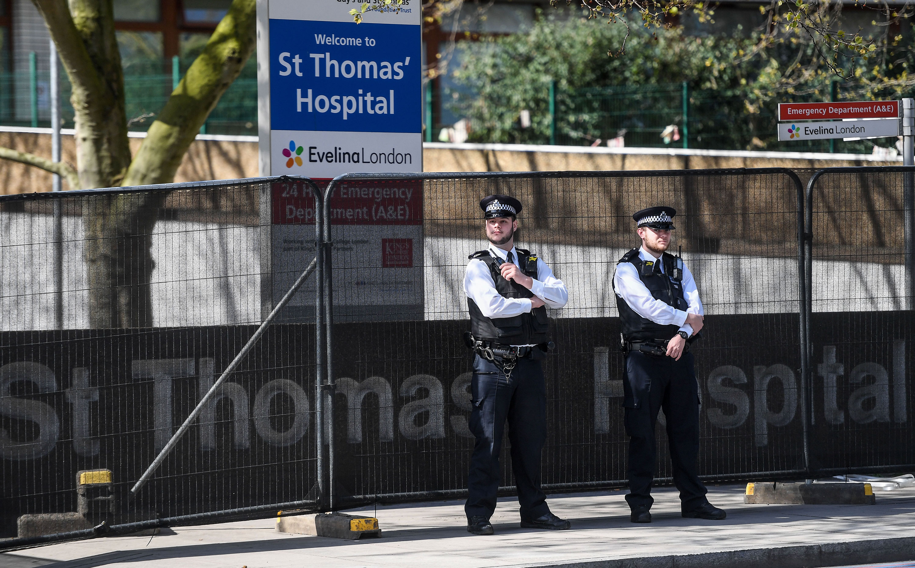 Police officers patrol outside St Thomas' Hospital  in London on April 7.