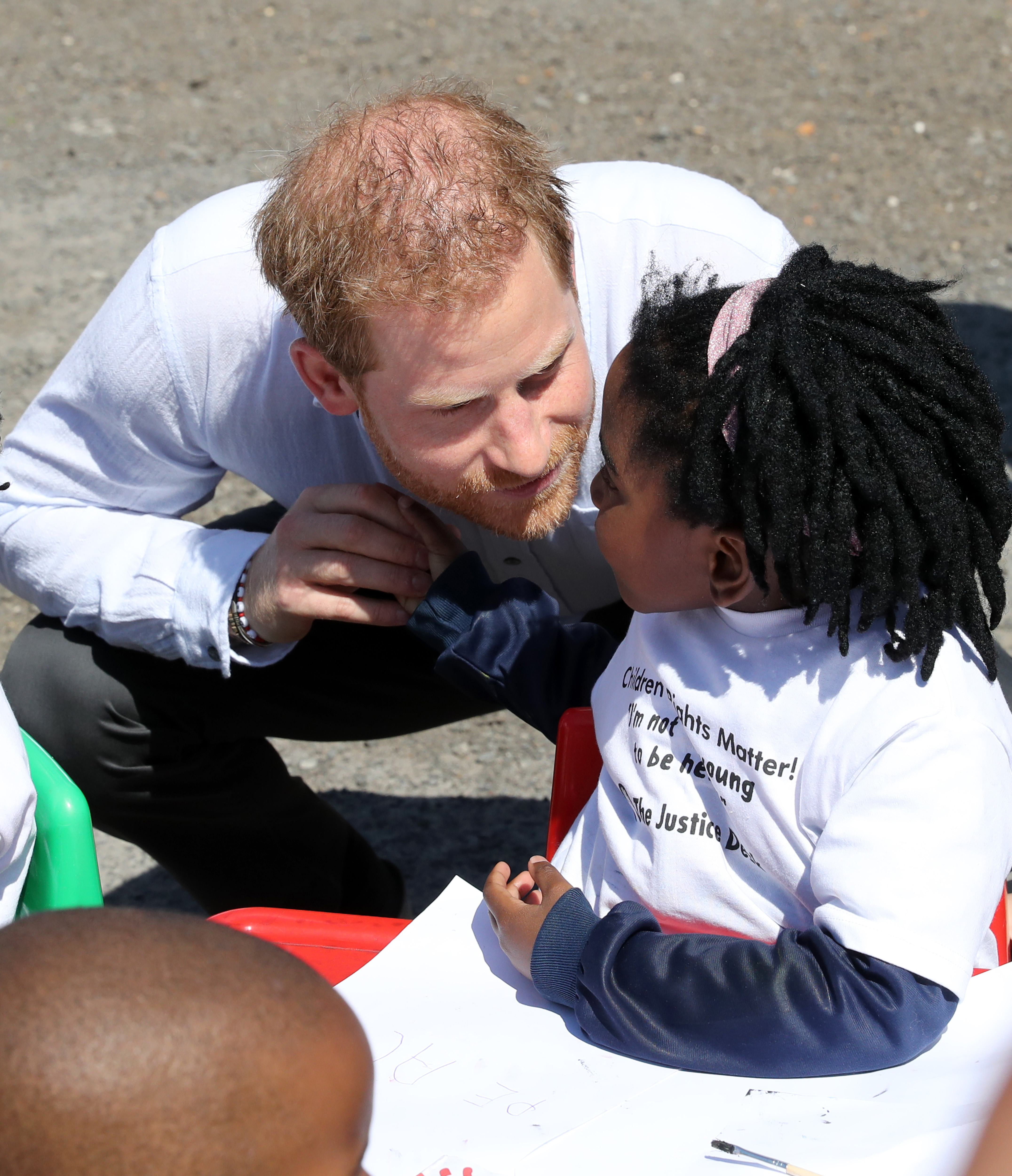 Prince Harry appeared to be a big hit with the young well-wishers gathered in Nyanga.