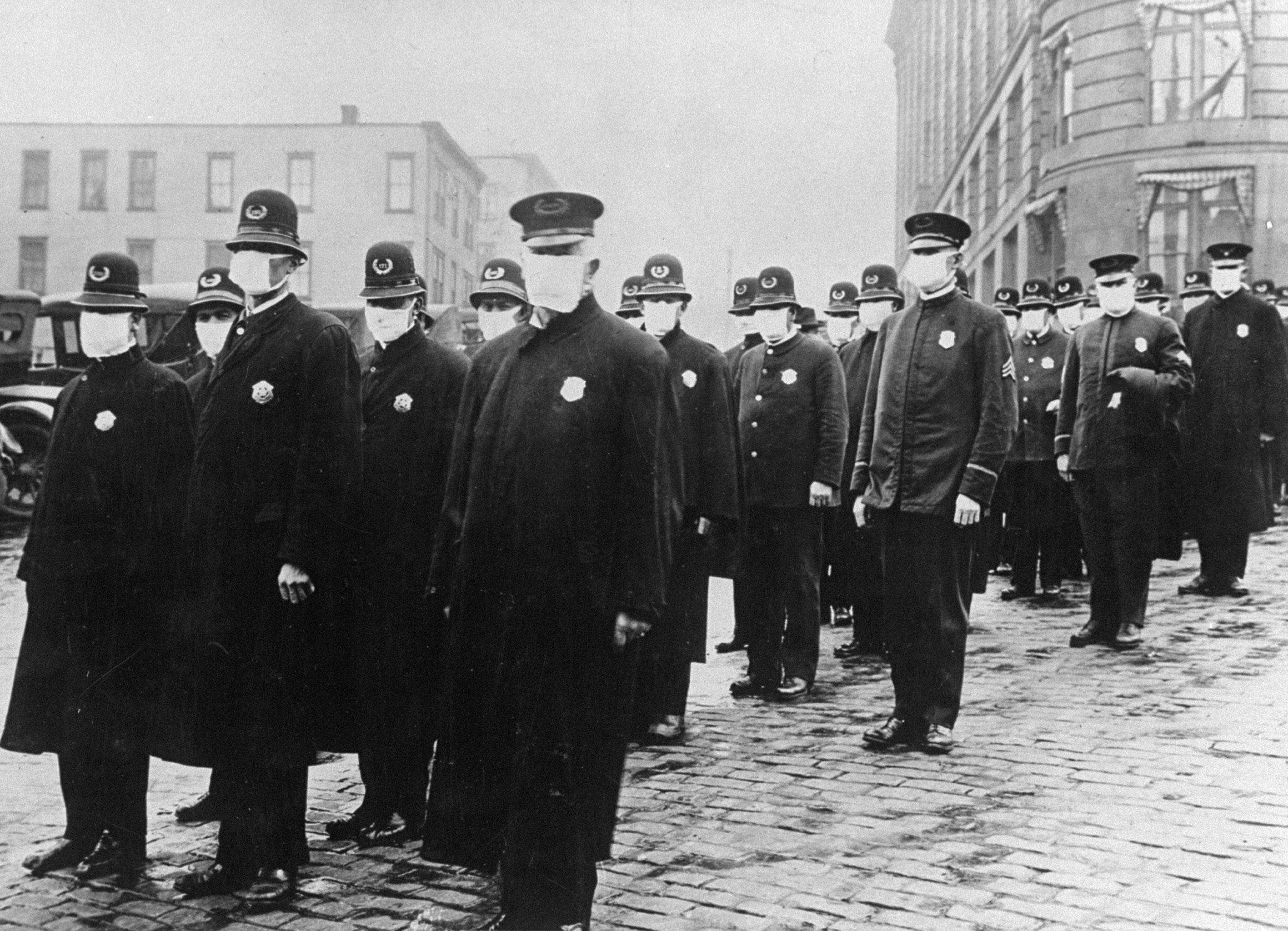 Seattle policemen wear protective face masks during influenza epidemic of 1918.