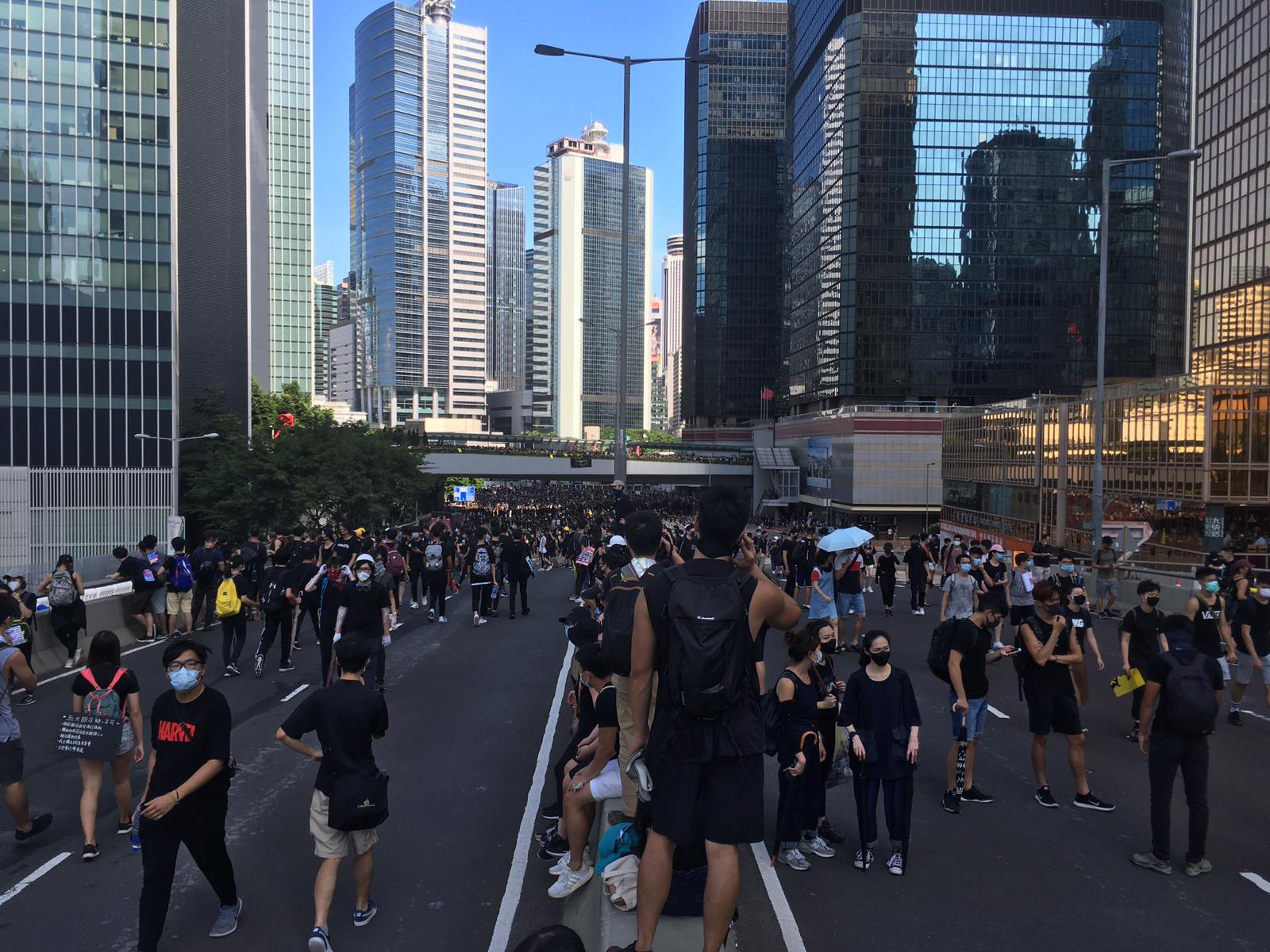 Protesters occupy Harcourt Road, a major thoroughfare on Hong Kong island, on Monday afternoon.