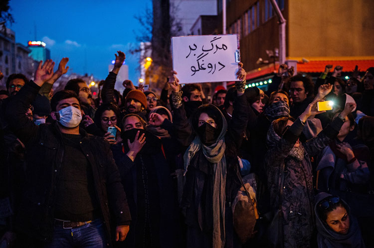 Mourners chant while gathering during a vigil for the victims of the Ukraine International Airlines flight that was unintentionally shot down by Iran, in Tehran on Saturday.
