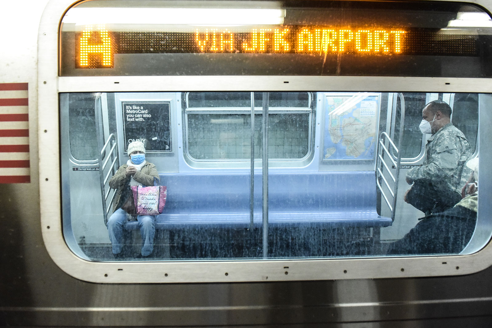 People ride the subway in New York City on May 6.
