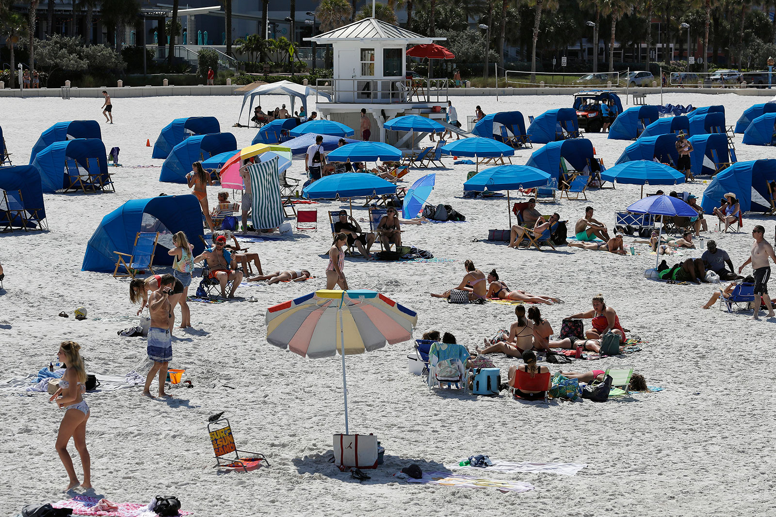 People visit a beach in Clearwater Beach, Florida, on March 18.