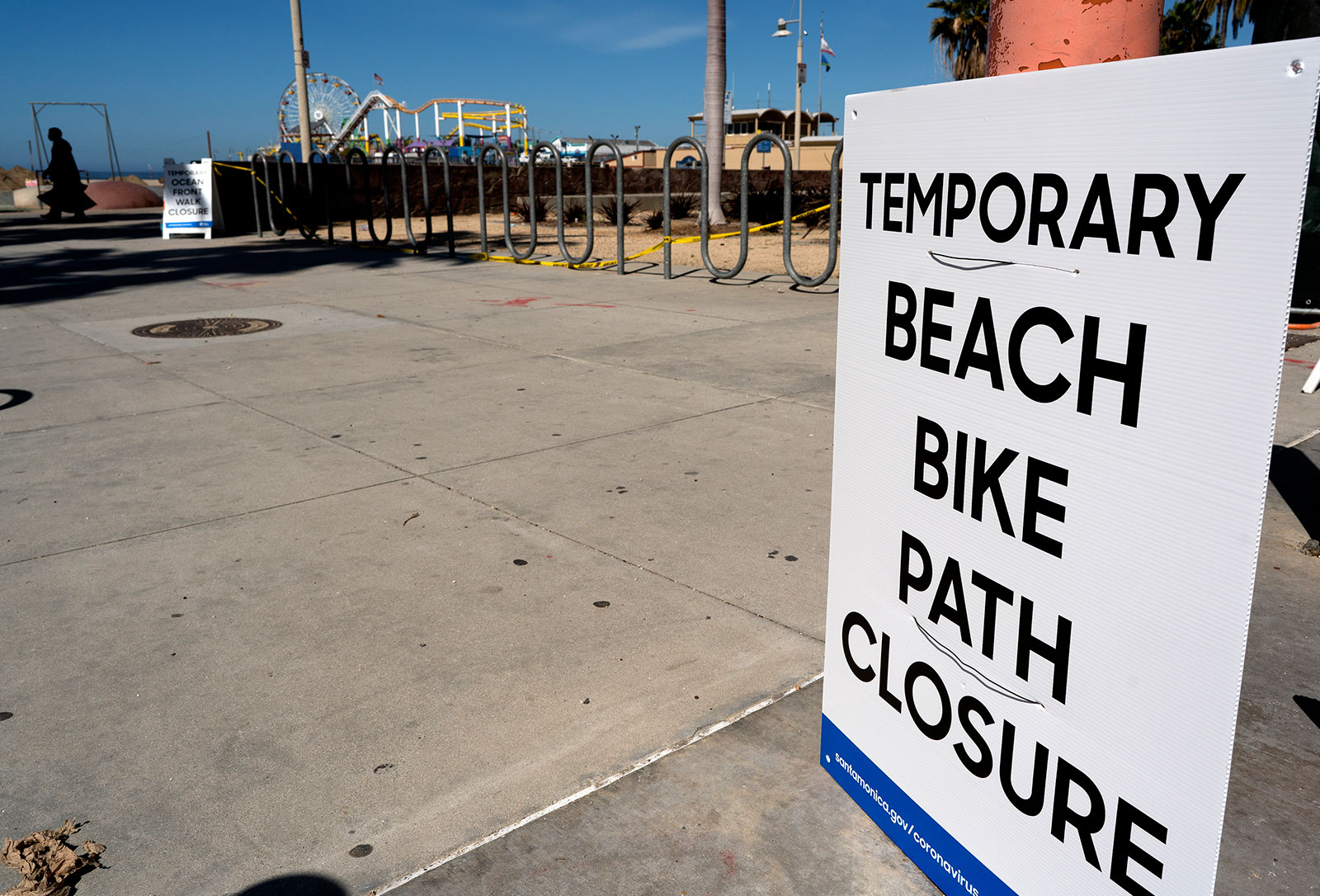 In an attempt to keep people social distancing due to COVID-19, a temporary closed sign is posted at the beach near the Santa Monica Pier in Santa Monica, California on April 23.