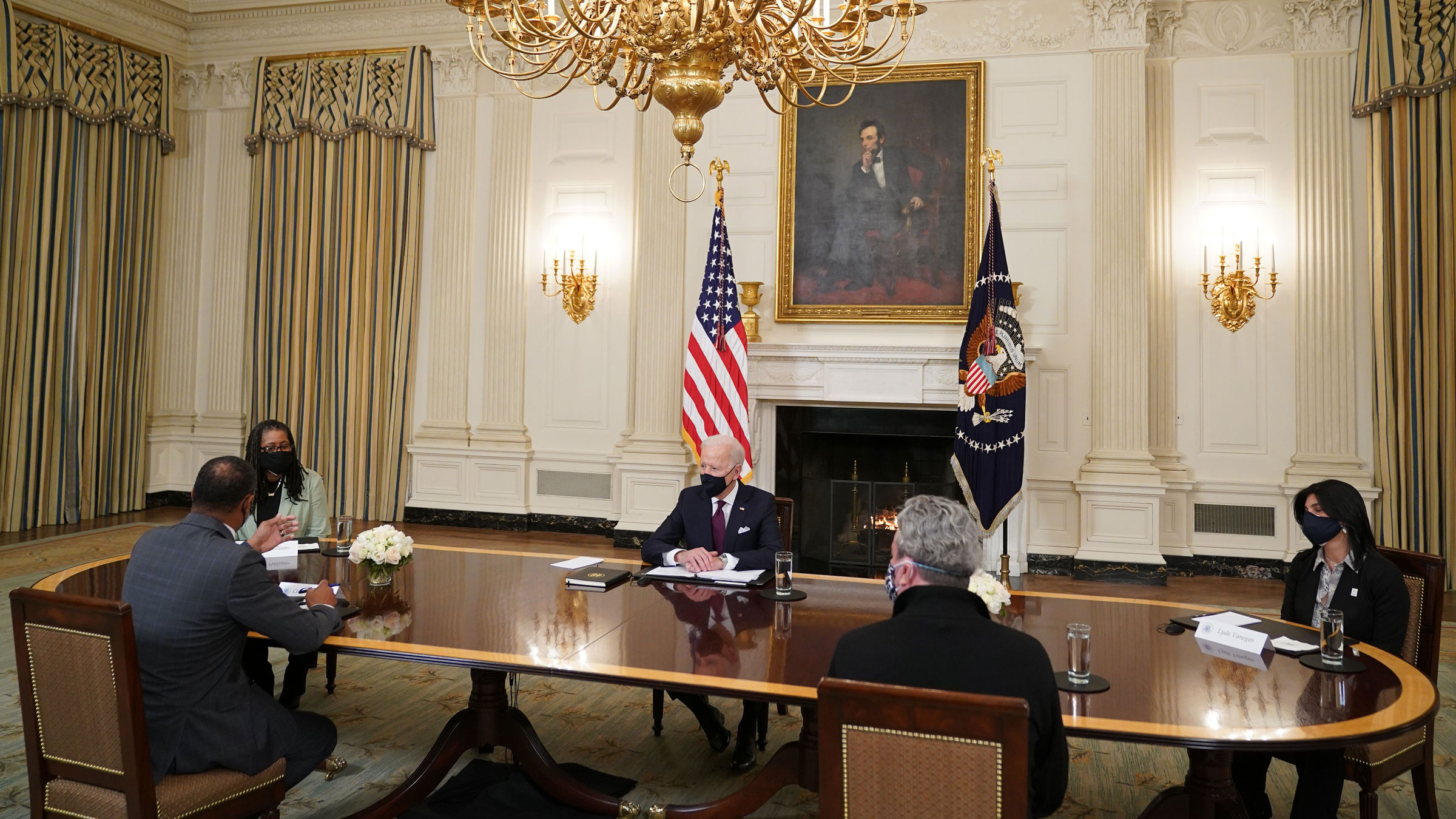 President Joe Biden takes part in a roundtable discussion Friday about the Covid-19 relief plan.