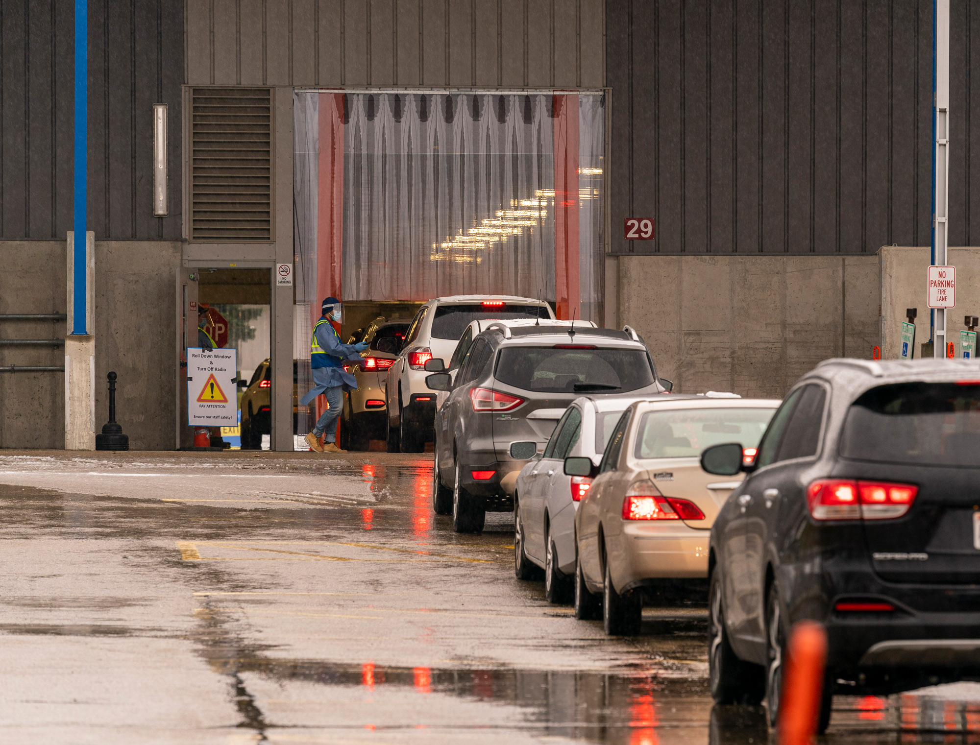 People queue up in their cars for a COVID-19 test at the Alliant Energy Center on November 24 in Madison, Wisconsin.