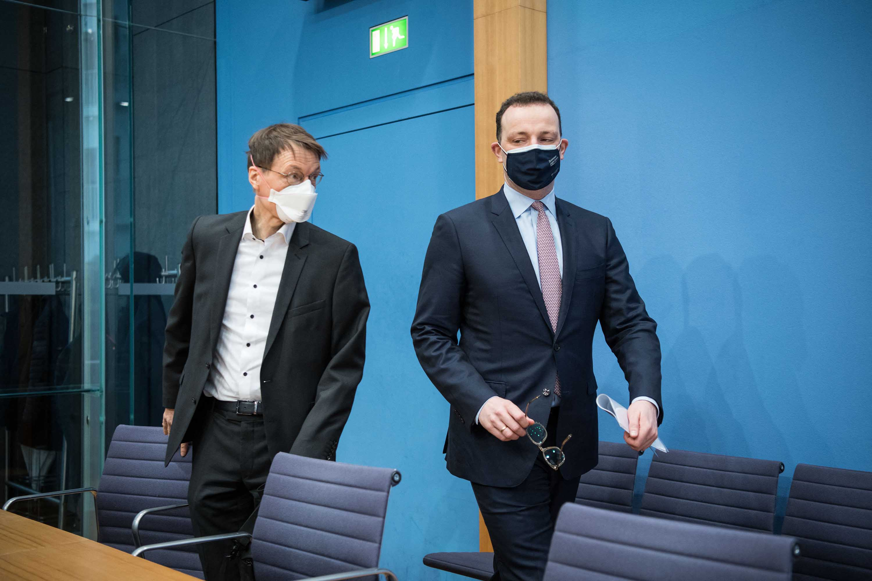 German Health Minister Jens Spahn, right, and German public health expert Karl Lauterbach arrive for a news conference on March 19, in Berlin.