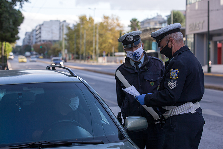 Policemen check on a driver for special permission to go outdoors in Athens, Greece, on November  7.