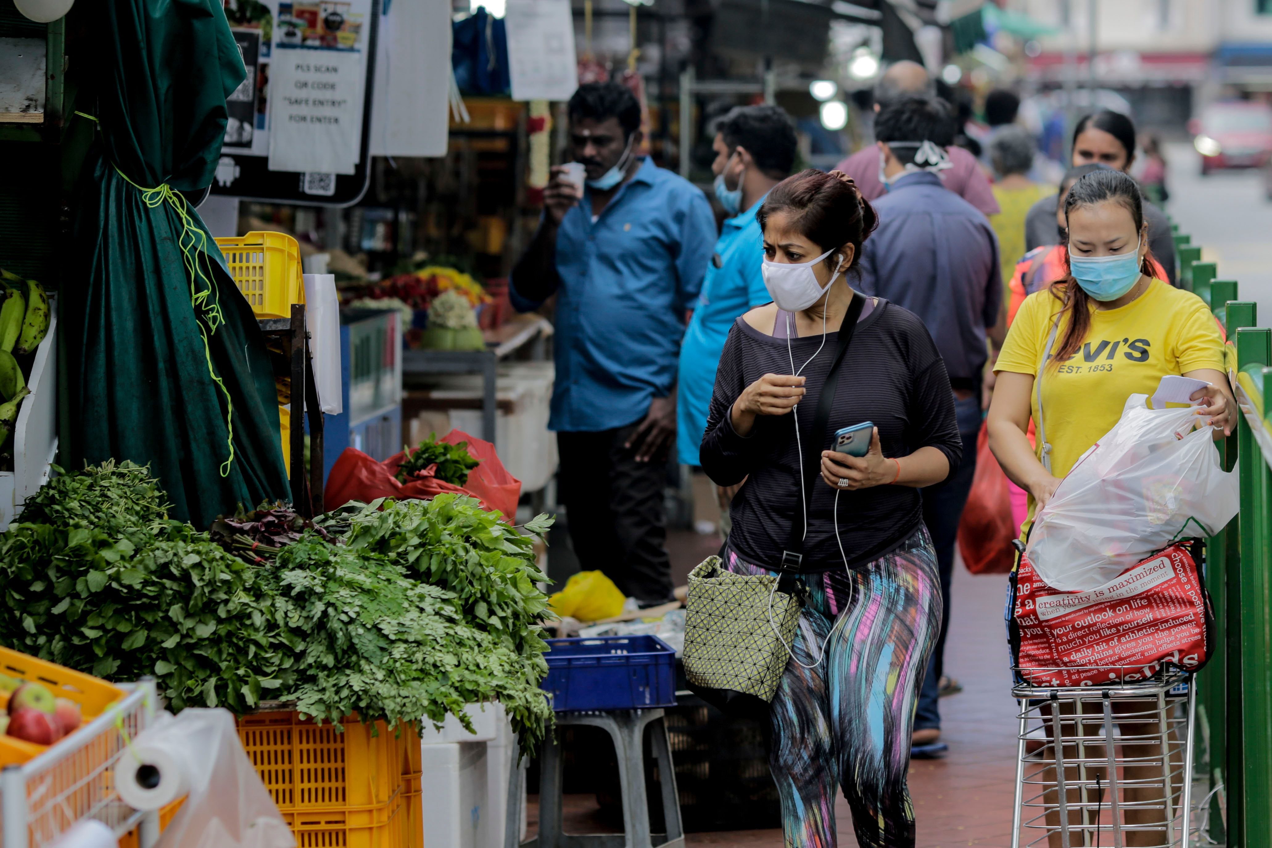 People visit the Little India district in Singapore on July 21.