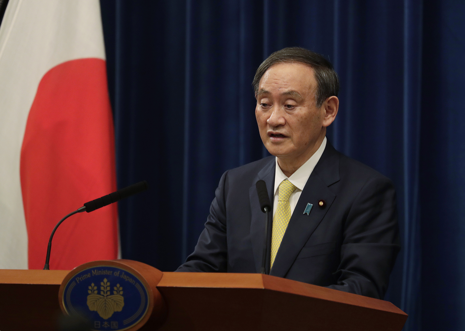 Yoshihide Suga, Japan's Prime Minister, speaks during a news conference in Tokyo on Friday, December 4.