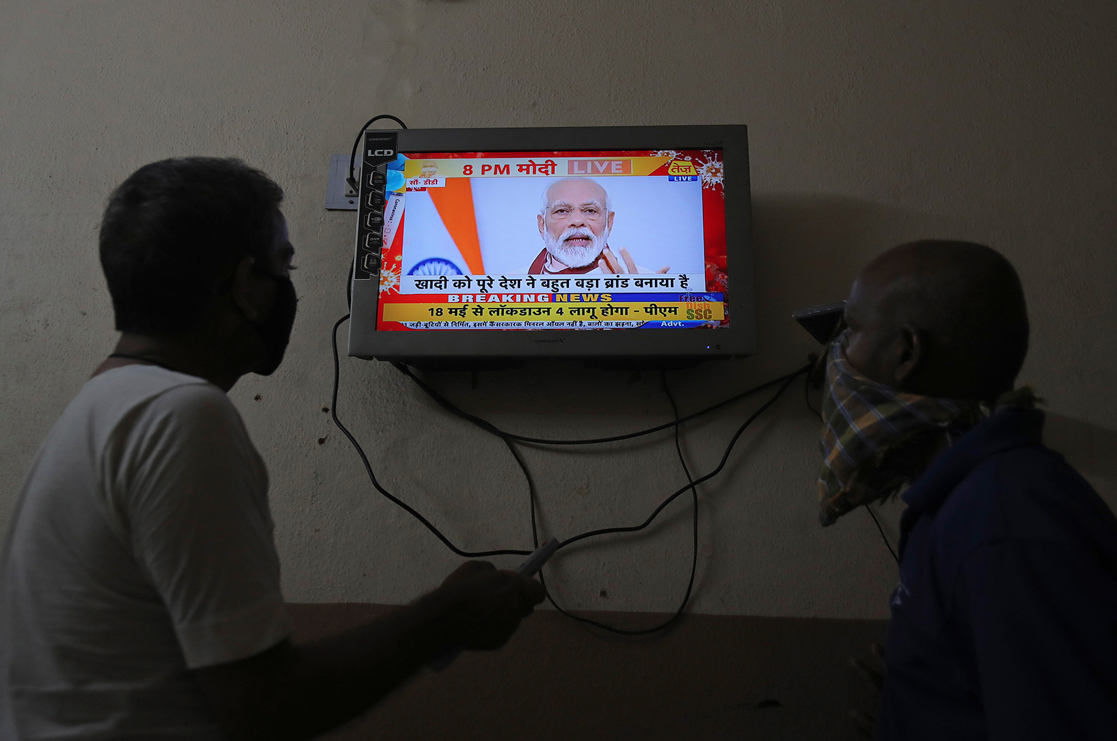 Viewers in India watch a televised address to the nation by Prime Minister Narendra Modi in Hyderabad, India, on Tuesday, May 12.
