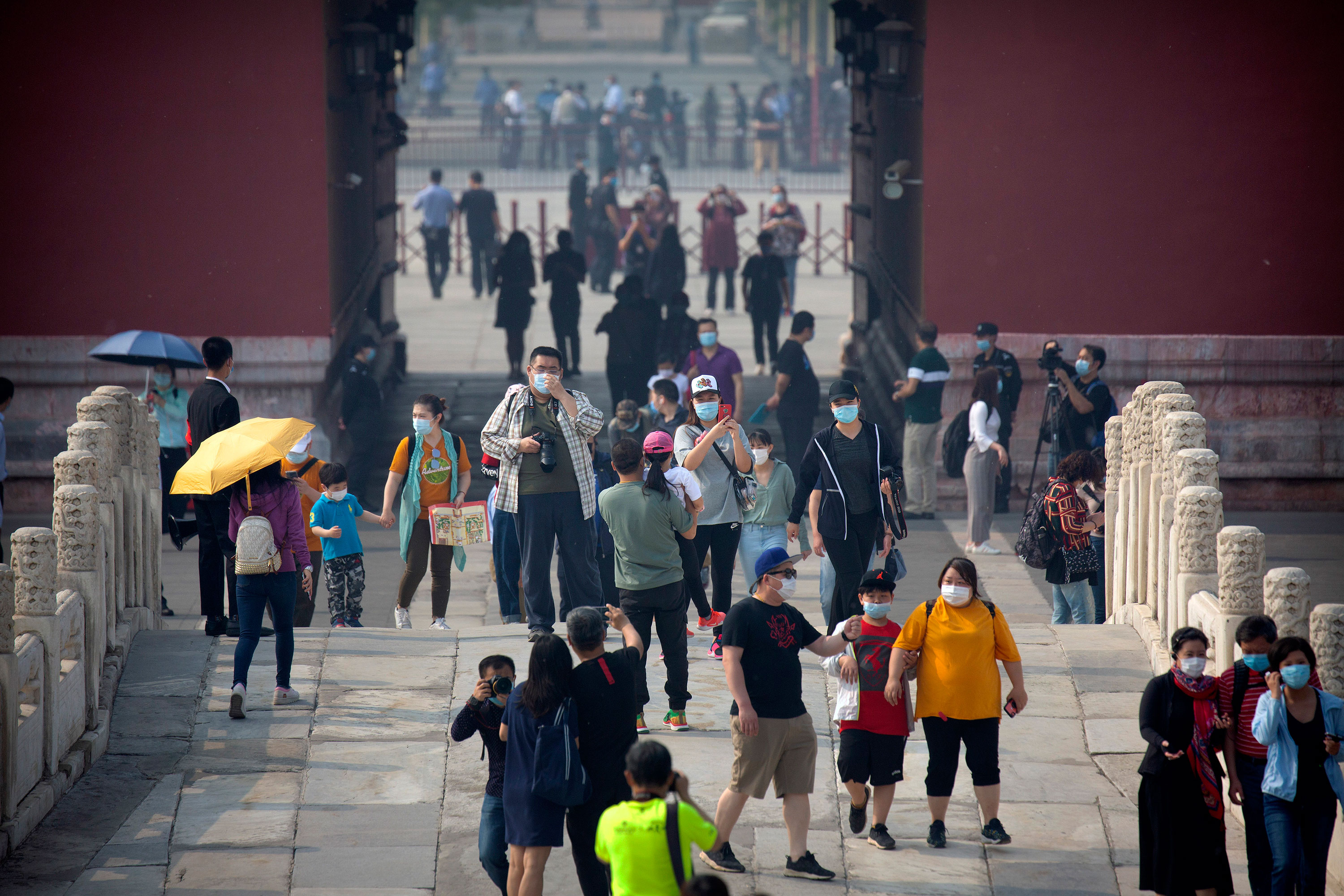 Visitors walk through the newly reopened Forbidden City in Beijing, China, on May 1.