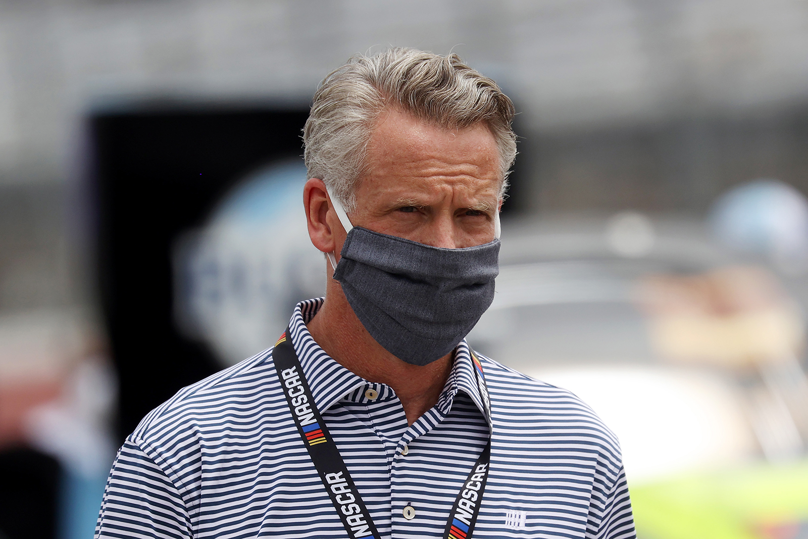NASCAR President Steve Phelps walks the grid prior to the NASCAR Cup Series The Real Heroes 400 at Darlington Raceway in Darlington, South Carolina on May 17.