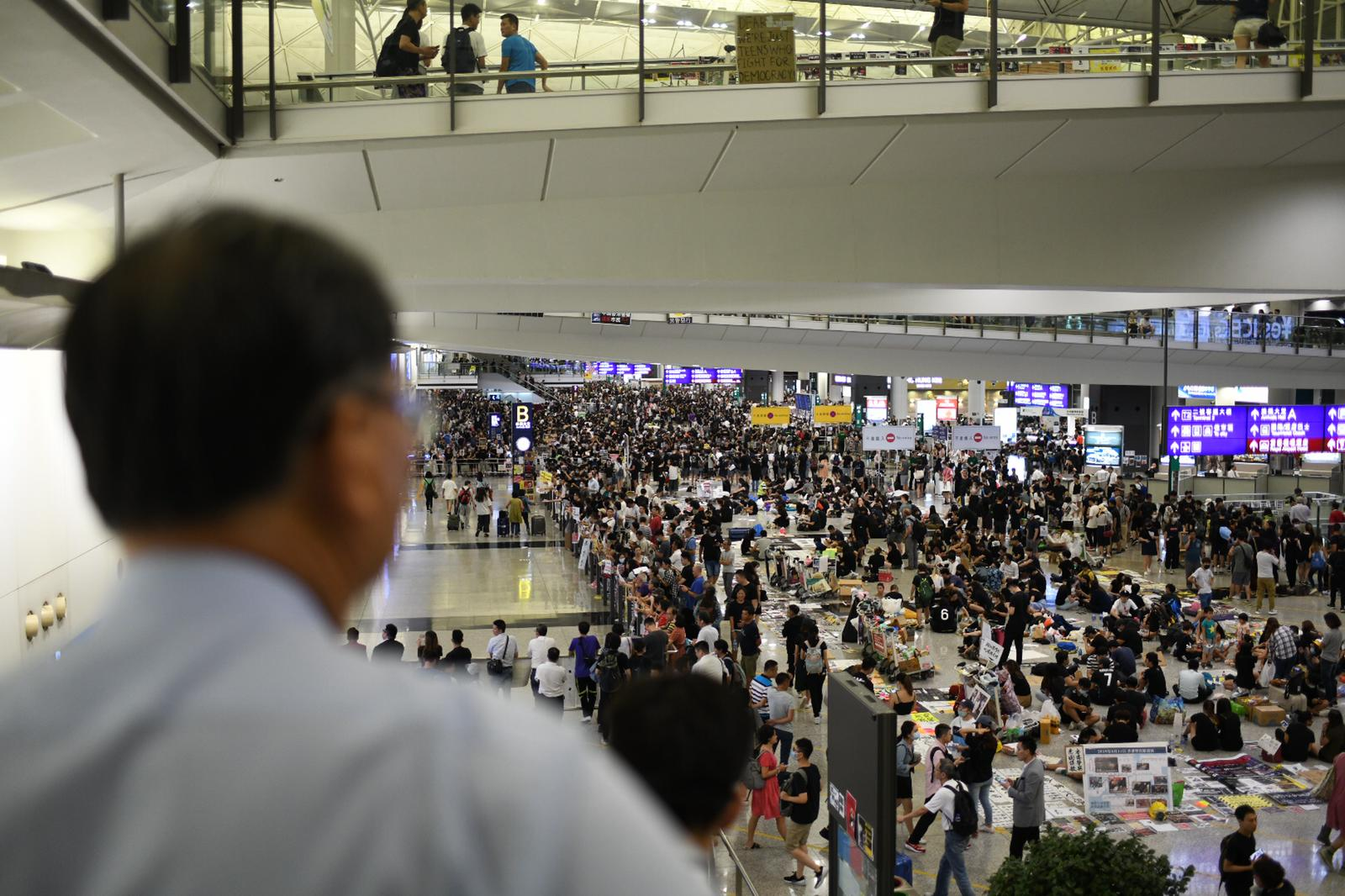 Hundreds of protesters occupy Hong Kong's international airport for the second day in a row.