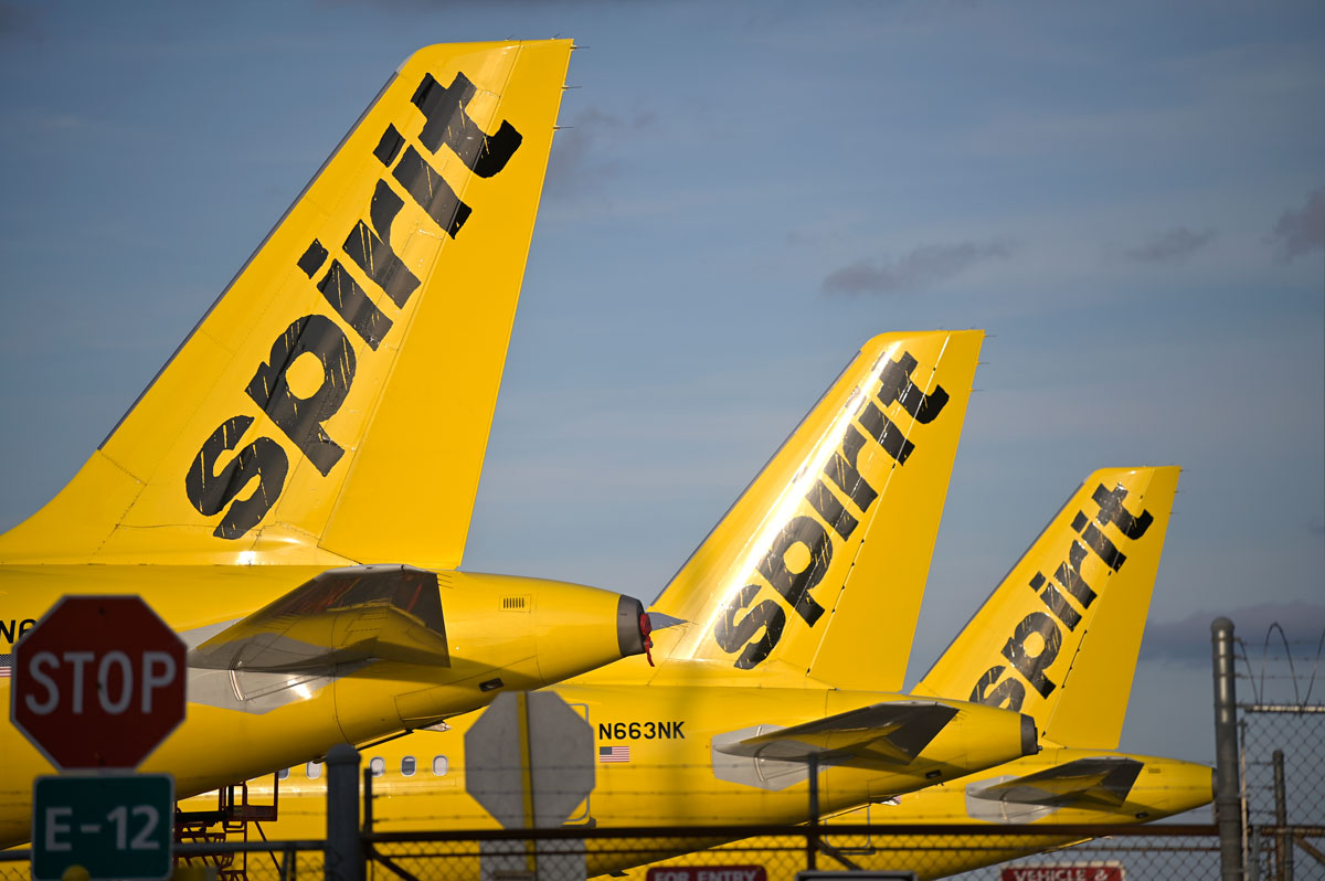 Spirit Airlines passenger jets are parked outside a hangar at Orlando International Airport on April 18, 2020, in Orlando, Florida.