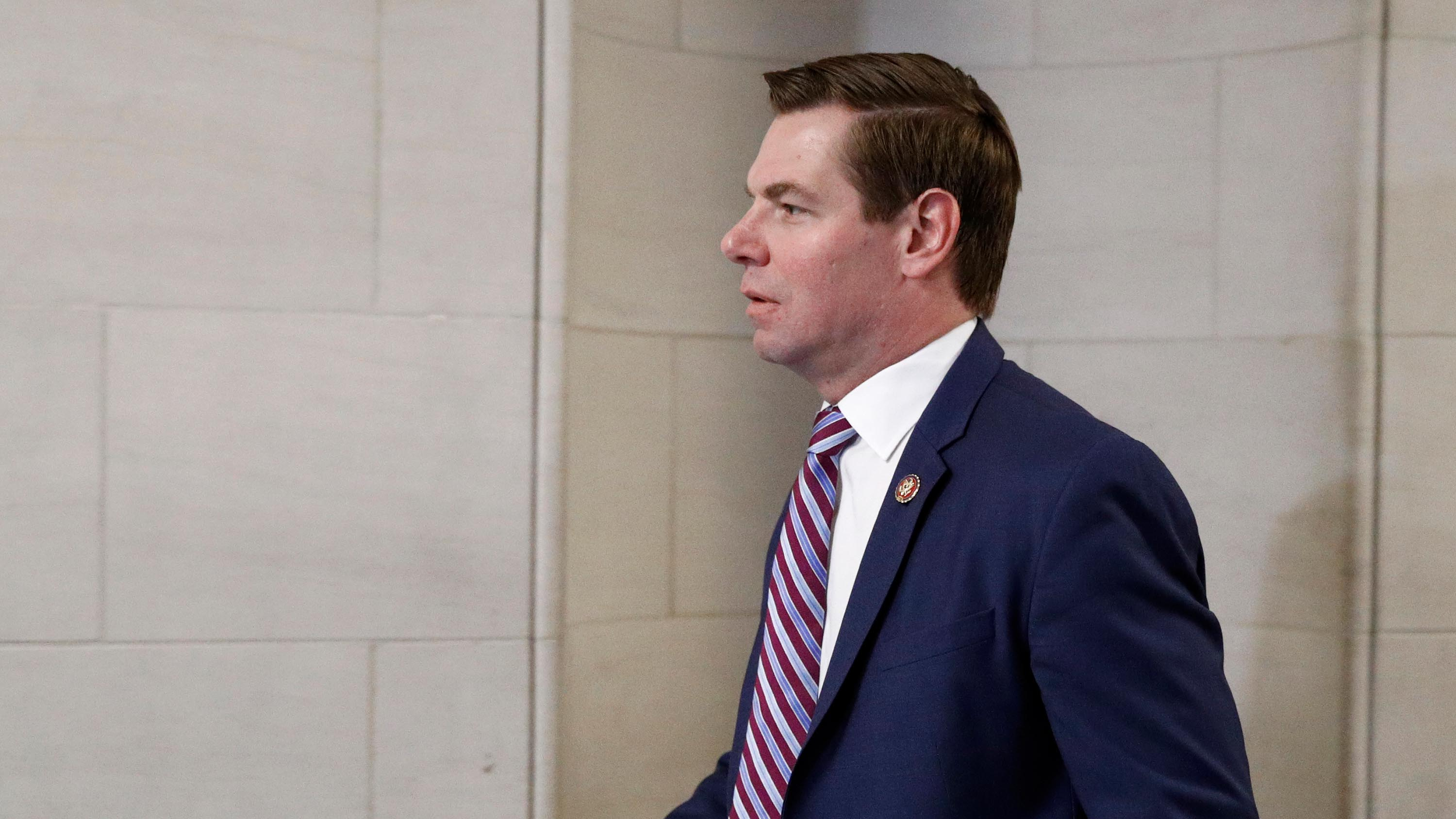 Rep. Eric Swalwell walks to a hearing room on Monday, December 9.