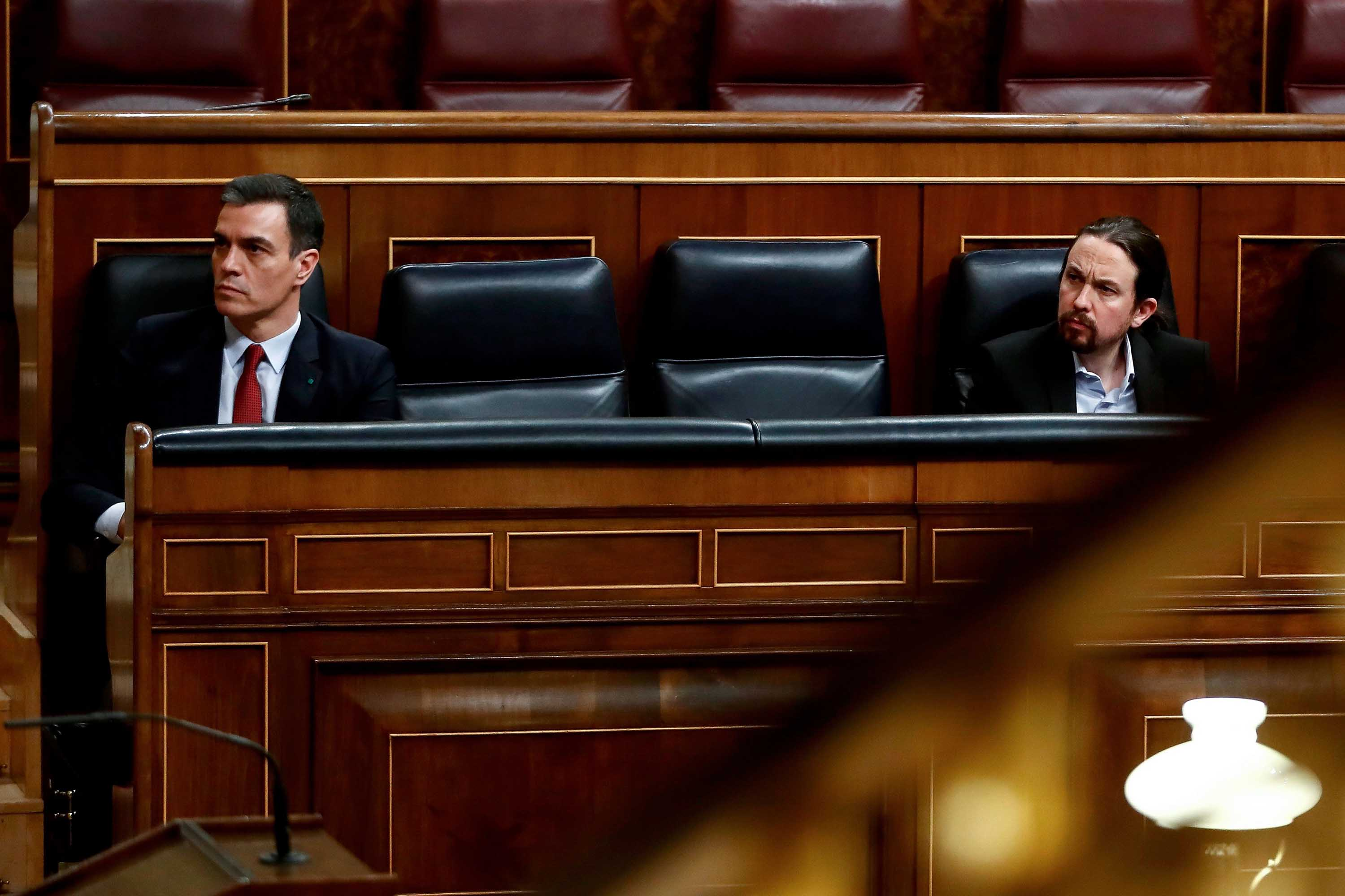 Second deputy Spanish Prime Minister Pablo Iglesias, right, attends a legislative session alongside Spanish Prime Minister Pedro Sanchez in Madrid, Spain, on March 25.