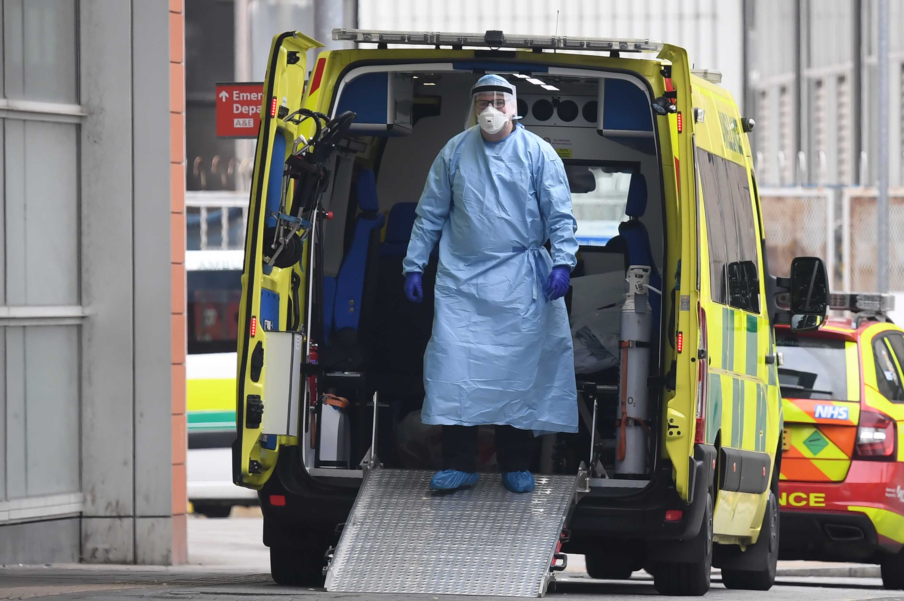 A health worker wears personal protective equipment in an ambulance after transferring a patient into The Royal London Hospital on April 18.