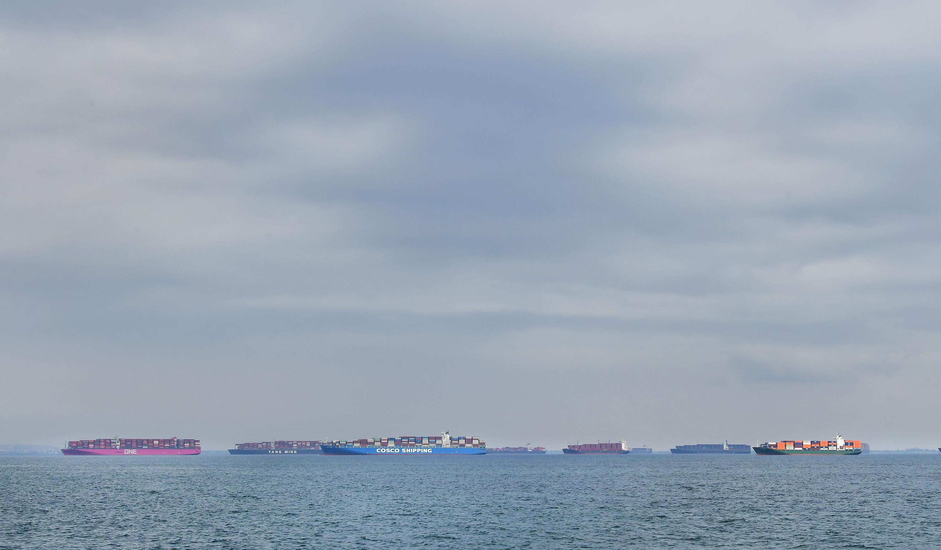 Cargo ships filled with containers wait offshore for entry to the Port of Los Angeles on October 6, 2021 in Los Angeles, California as supply chain disruptions continue to affect the US economy.