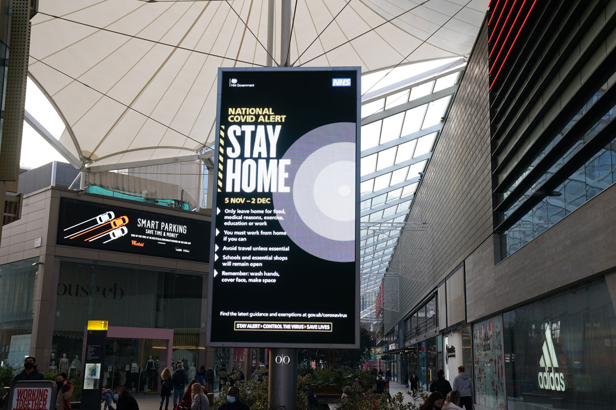 A billboard with UK Government signage asks people to stay home in the Westfield Shopping Centre in Stratford, London, as the four week national lockdown for England to combat the spread of Covid-19 continues.