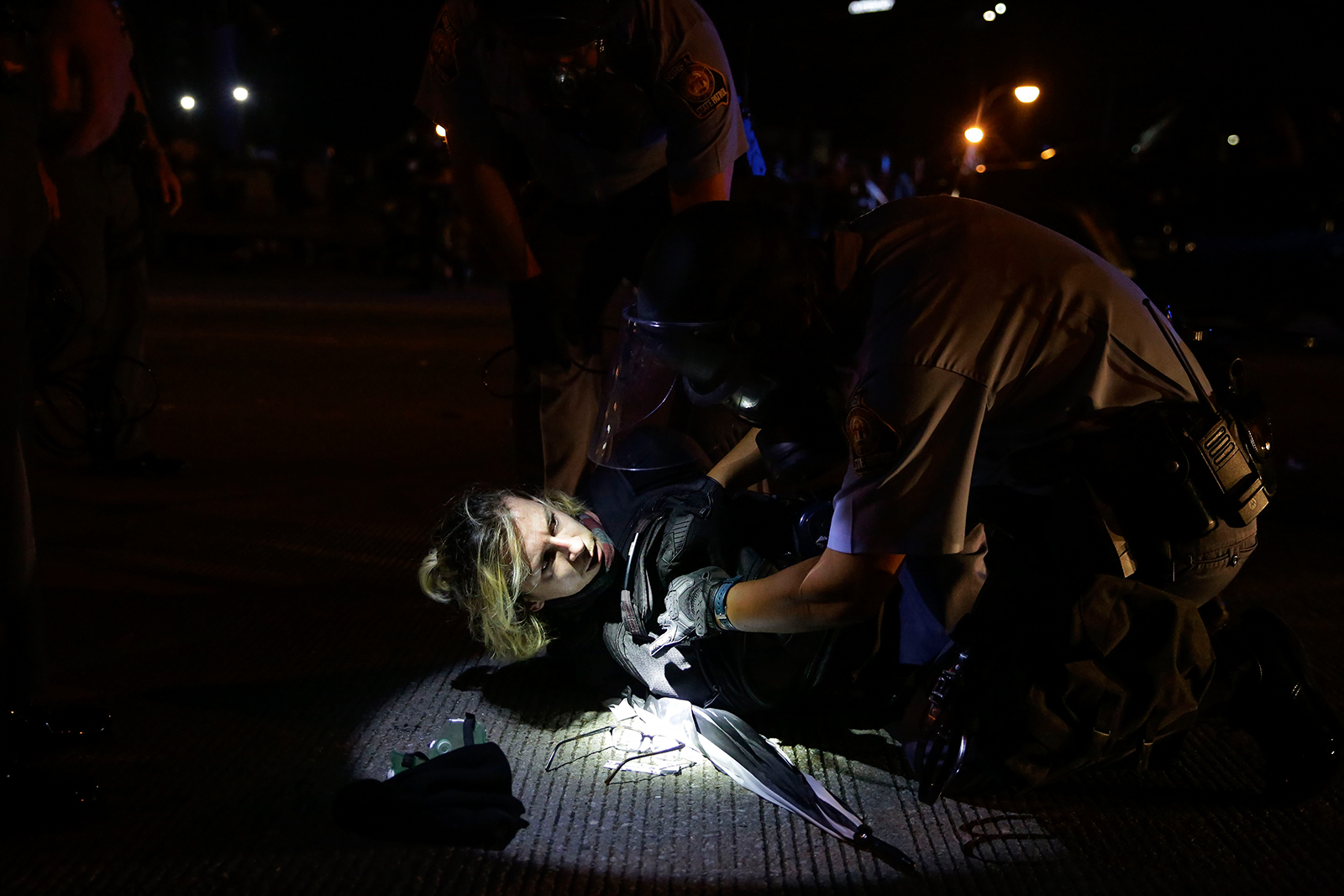 A person is detained during protests on Saturday, June 13, near the Atlanta Wendy's where Rayshard Brooks was shot and killed by police Friday evening following a struggle in the restaurant's drive-thru line in Atlanta.