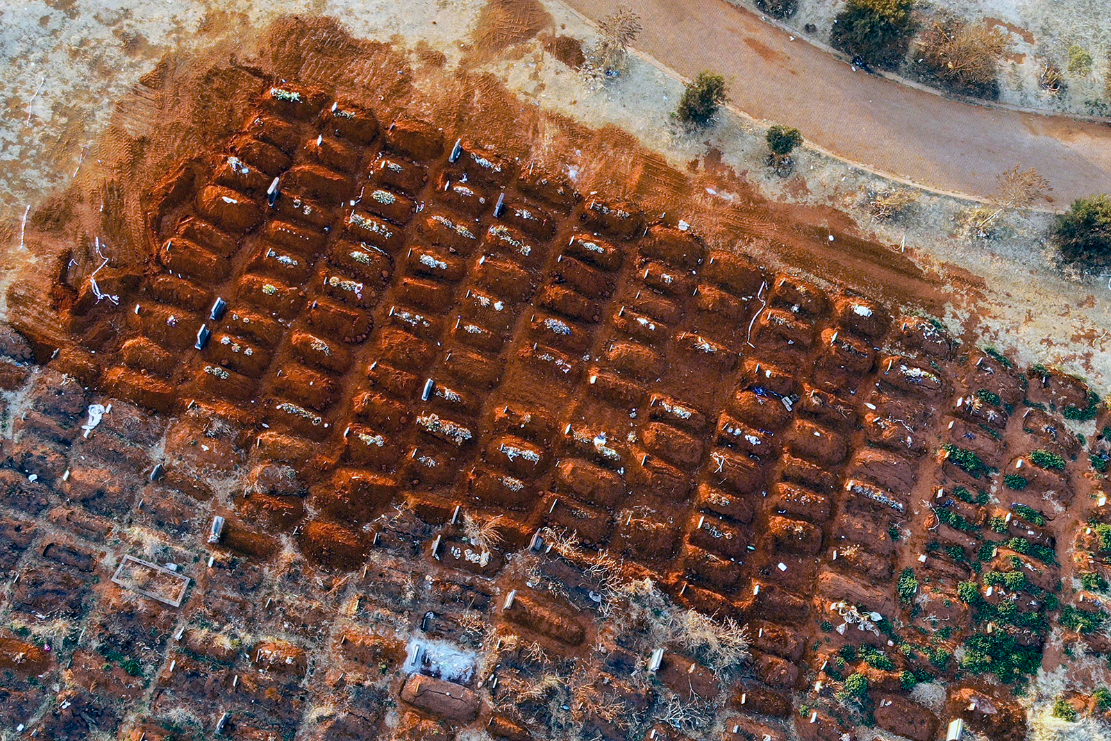 Recently filled graves are seen in the Olifantsveil Cemetery outside Johannesburg, South Africa, on Wednesday Aug. 5.