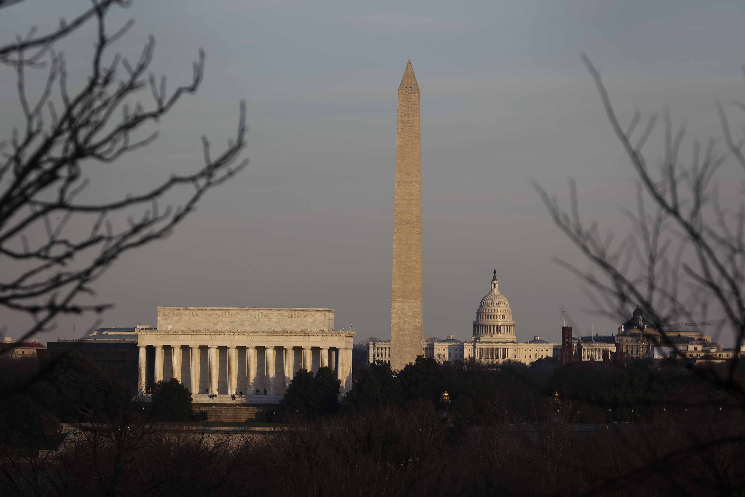 The Lincoln Memorial, left, Washington Monument, center, and U.S. Capitol Building are seen from Arlington, Virginia, on December 27.