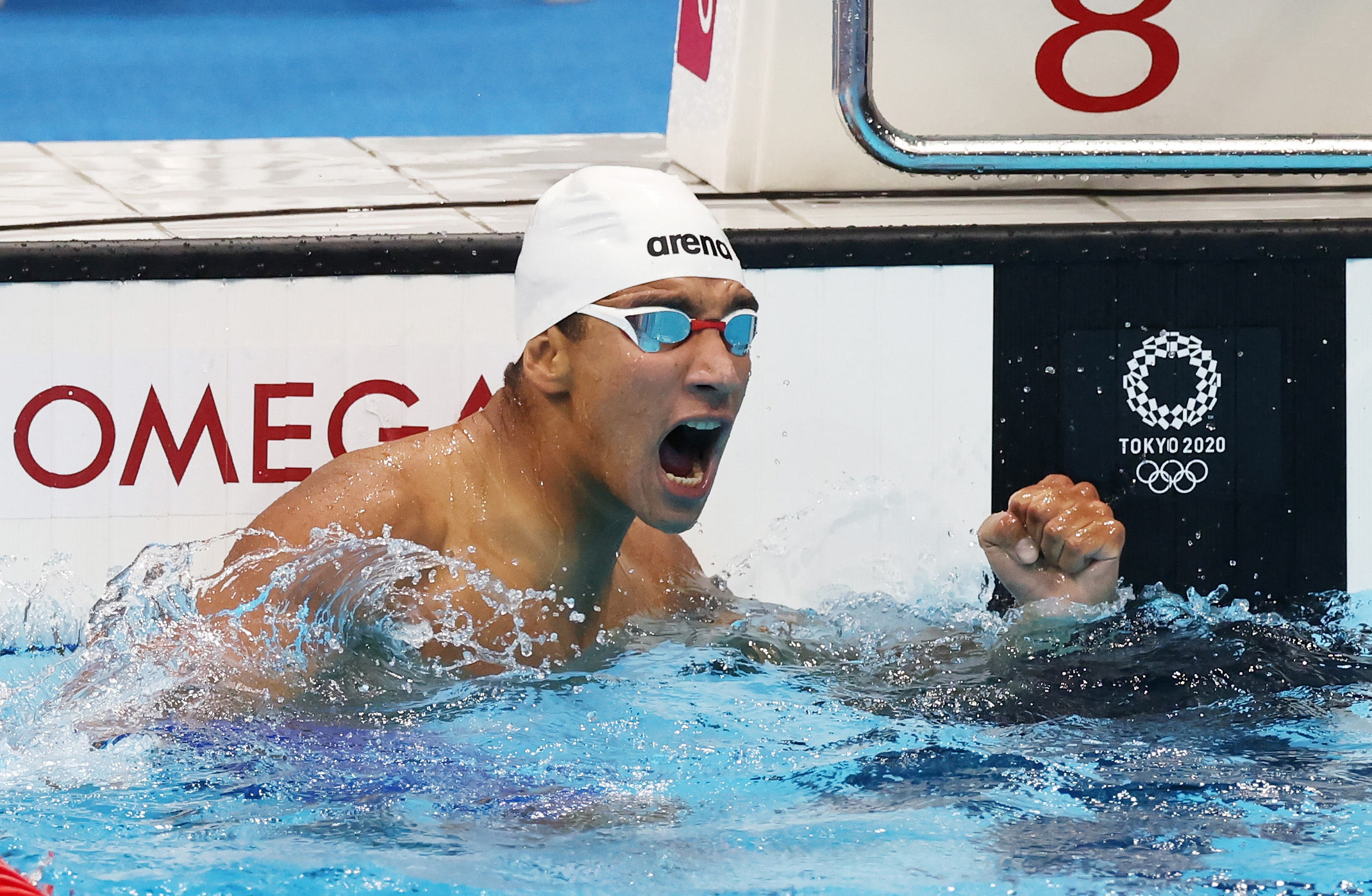 Ahmed Hafnaoui of Team Tunisia celebrates after winning the gold medal in the 400m freestyle final on July 25.