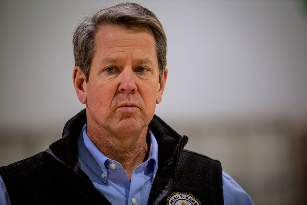 Georgia Gov. Brian Kemp listens to a question from the press during a tour of a massive temporary hospital at the Georgia World Congress Center on Thursday, April 16, in Atlanta.