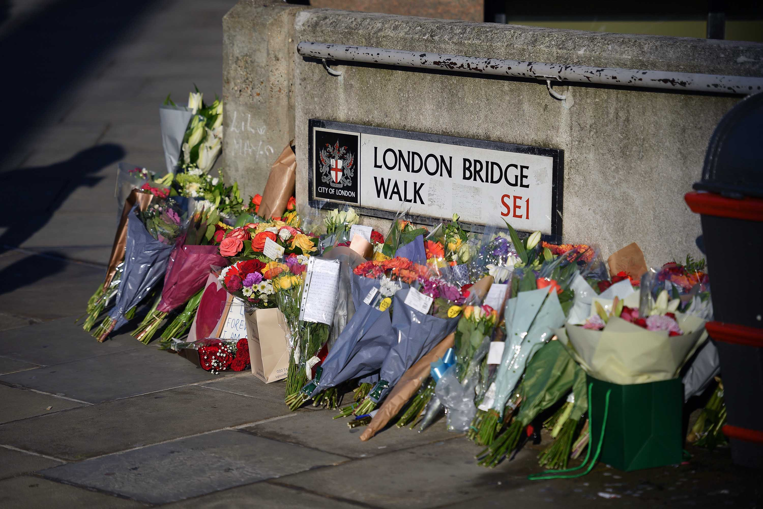 Bouquets of flowers are placed in tribute to the victims of last week's terrorist attack at London Bridge.