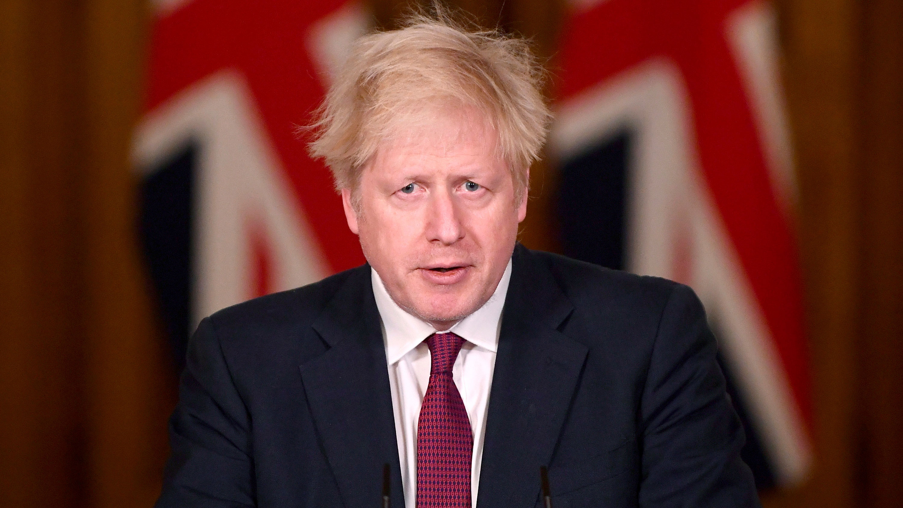 Britain's Prime Minister Boris Johnson speaks during a news conference in response to the ongoing situation with the coronavirus pandemic on December 19 in London.