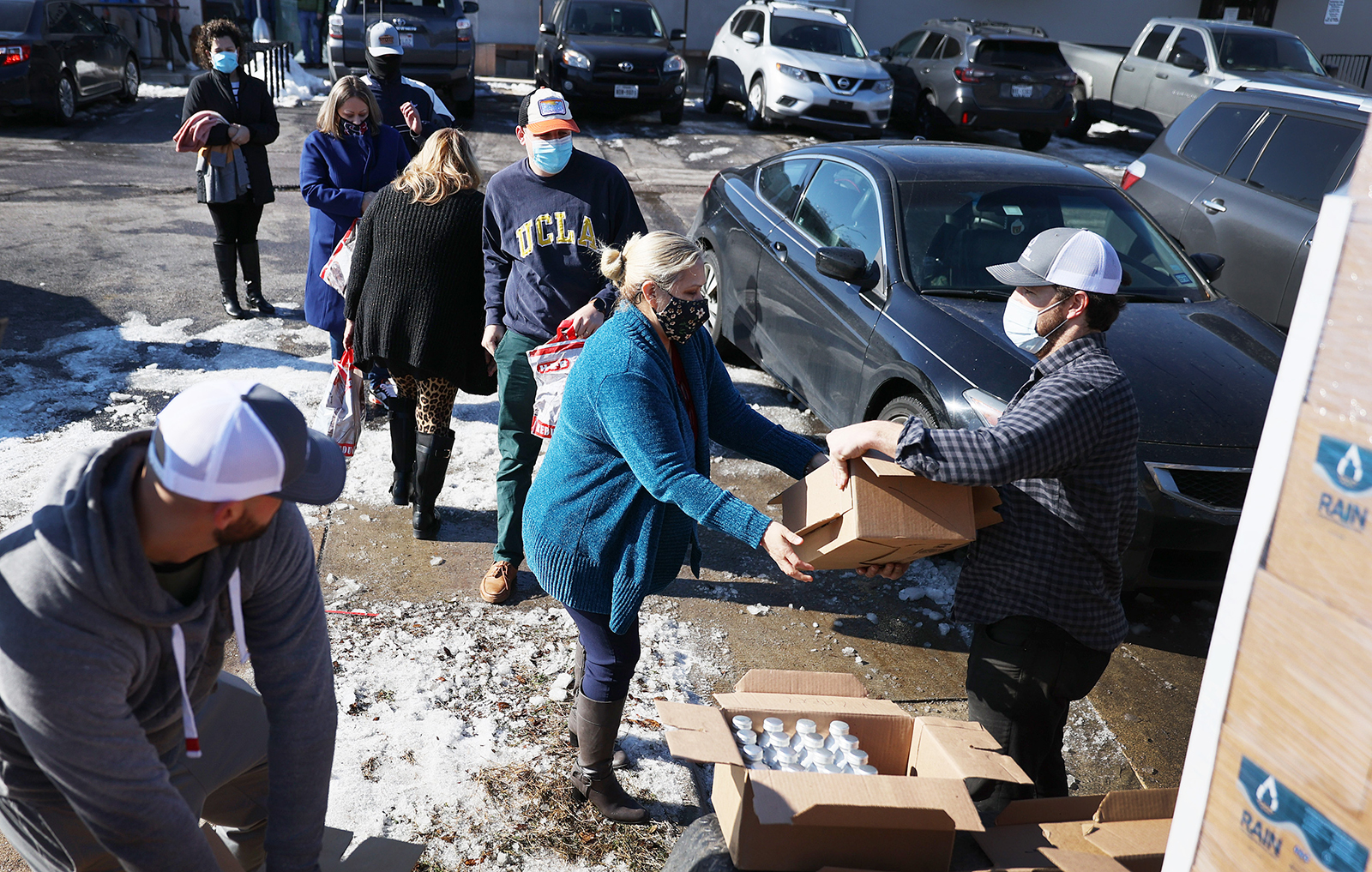 Mark Majkrzak gives out bottles of Rain Pure Mountain Spring Water to people in need on February 19, in Austin, Texas.