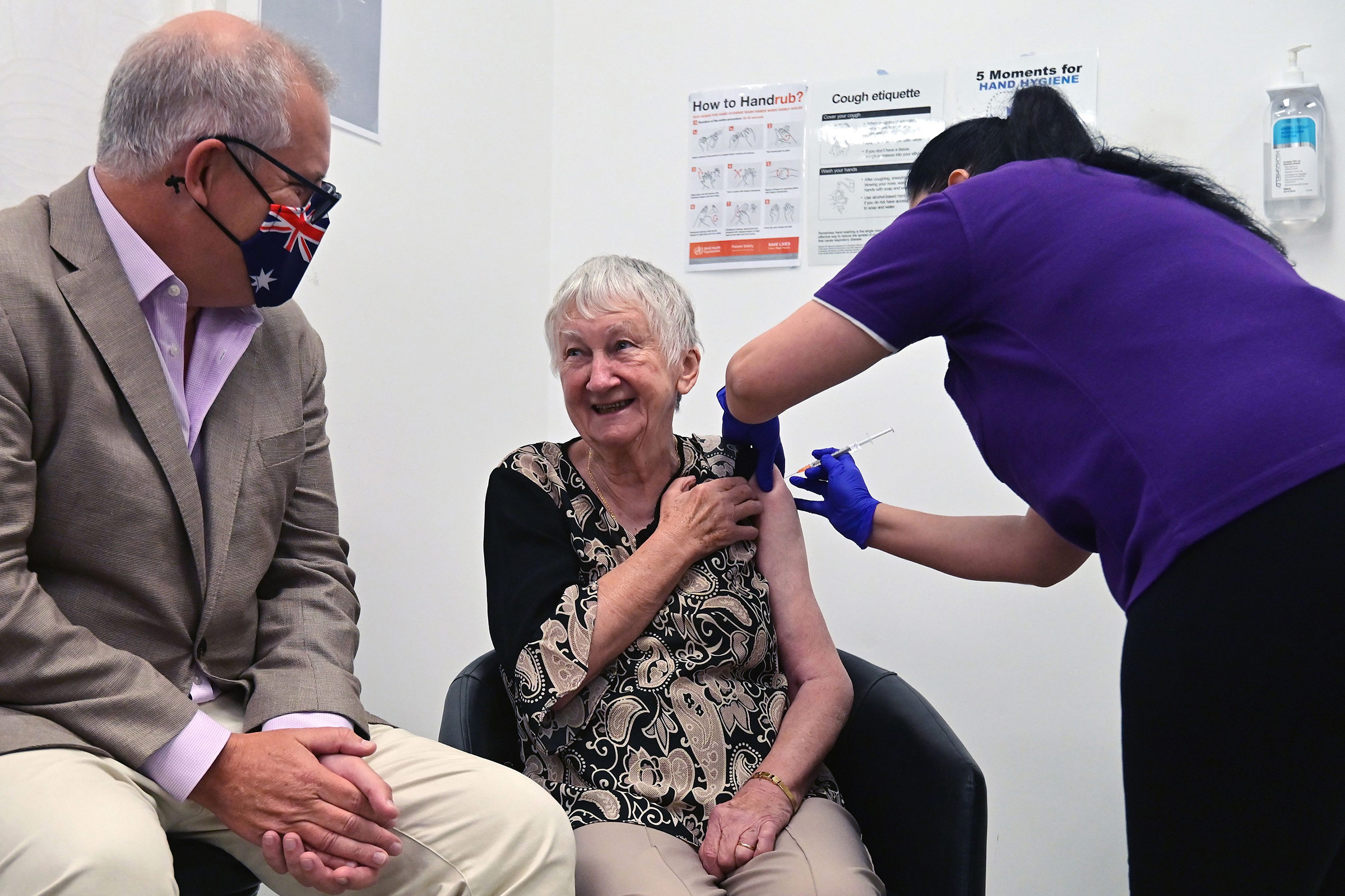 Australia's Prime Minister Scott Morrison looks on as Jane Malysiak becomes the first person in the country to receive a dose of the Pfizer/BioNTech Covid-19 vaccine in Sydney on February 21.