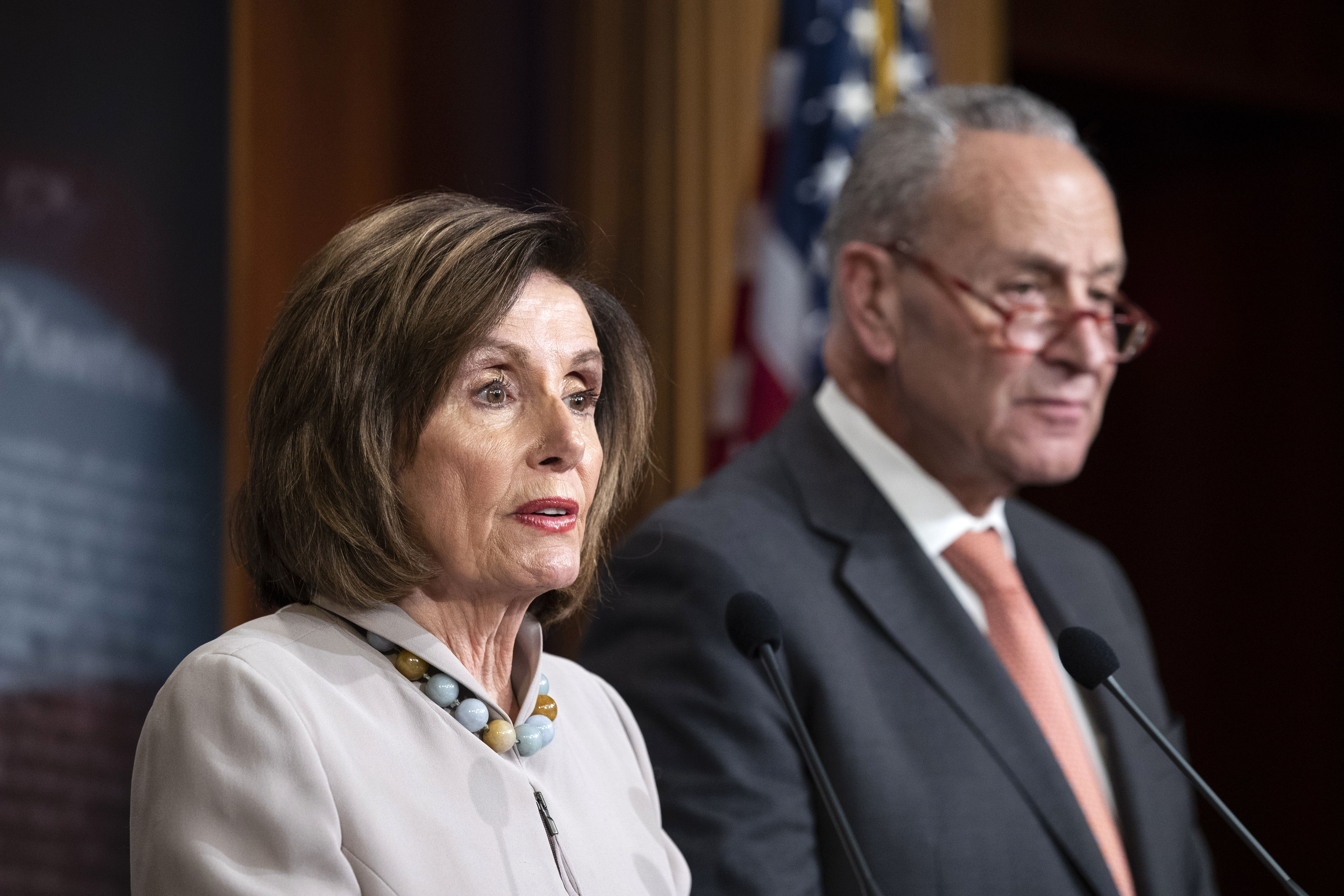 House Speaker Nancy Pelosi and Senate Minority Leader Chuck Schumer hold a news conference in Washington, DC, on February 11.