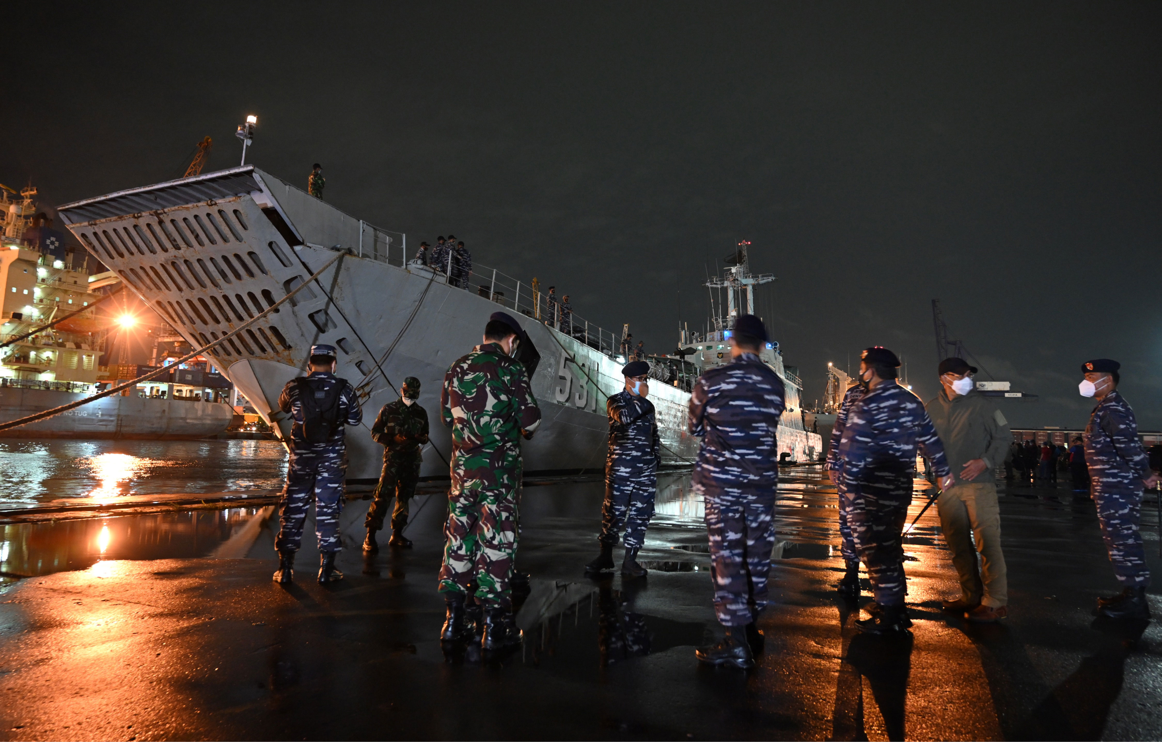 Navy personnel in Jakarta, Indonesia, oversee preparations for a search and rescue operation near the KRITelukGilimanuk(531) warship at Tanjung Priok port on January 9.