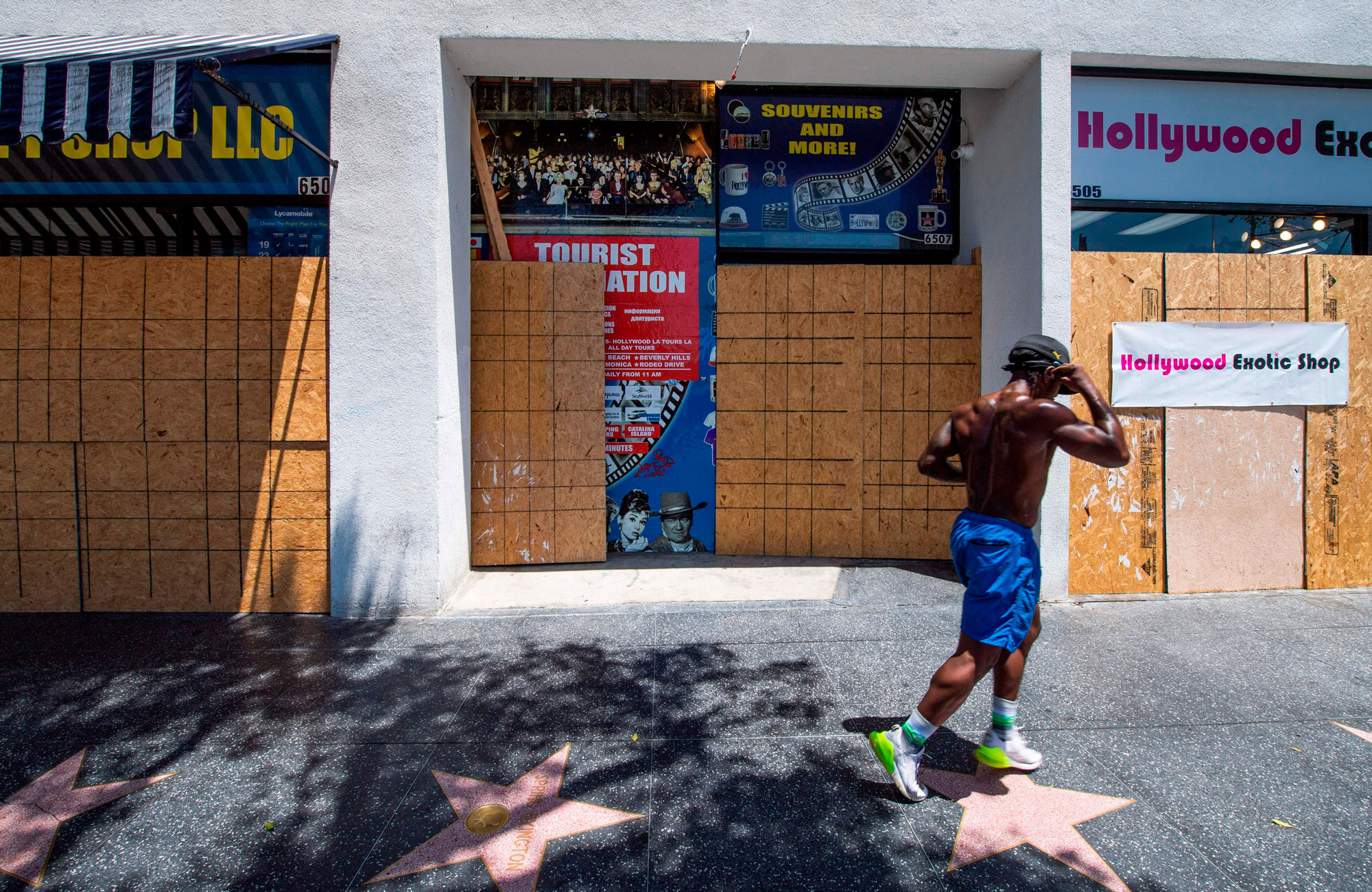 A man jogs past tourist shops on June 30 in Hollywood, California.