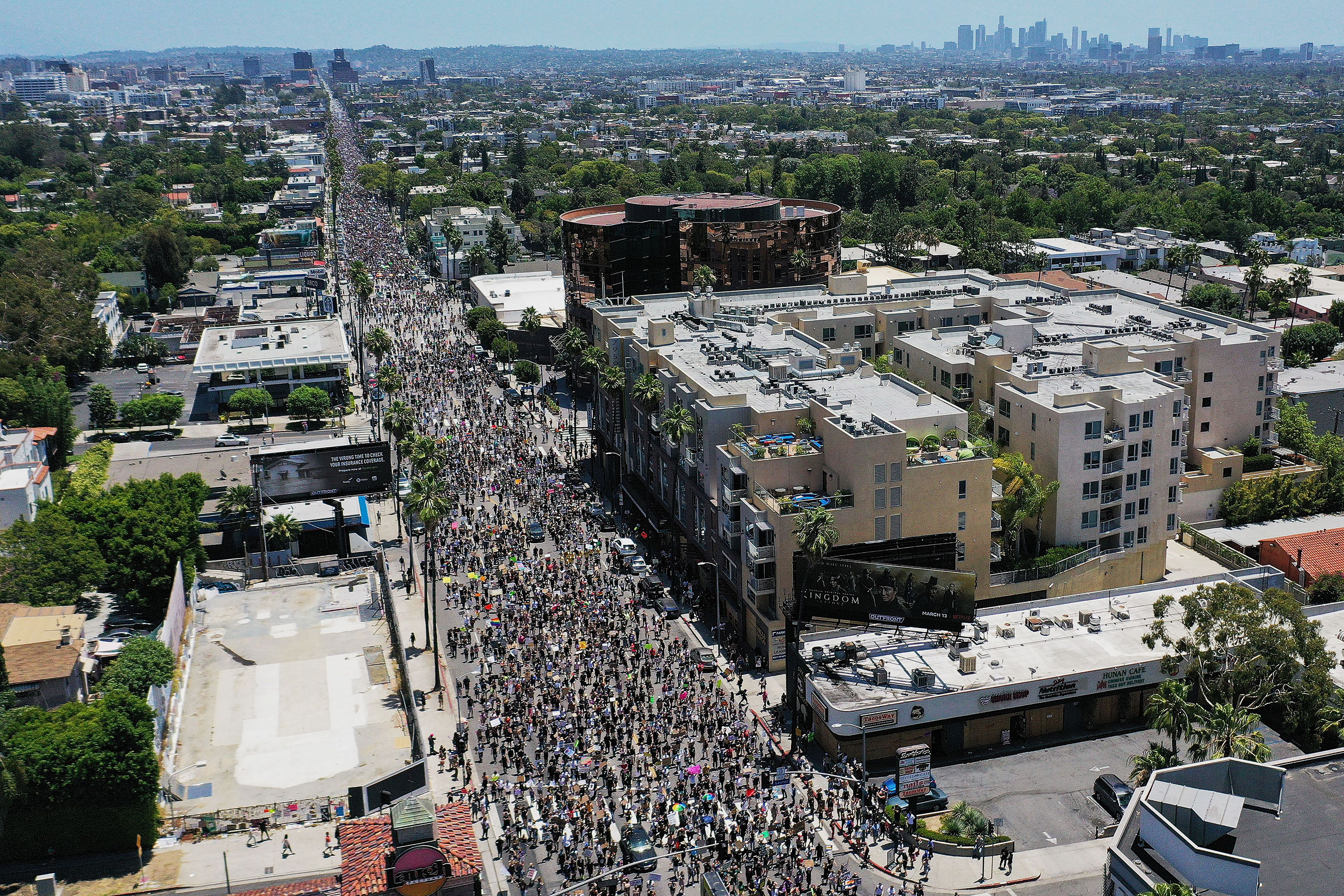 Protesters walk down Sunset Boulevard in Los Angeles, California, on June 14.