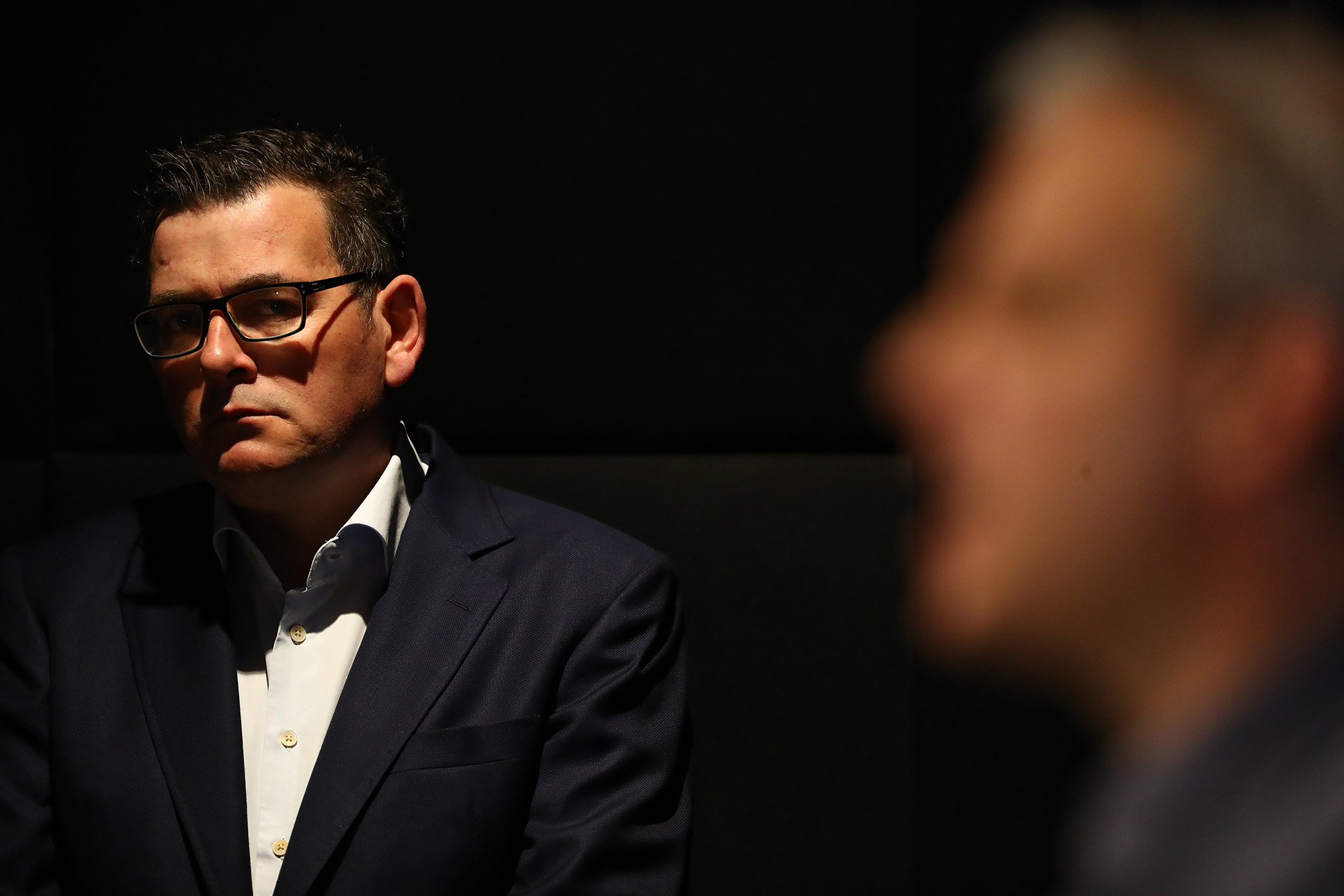 Victorian Premier Daniel Andrews listens as Victorian Chief Health Officer Brett Sutton speaks during a press conference on July 22, in Melbourne, Australia.