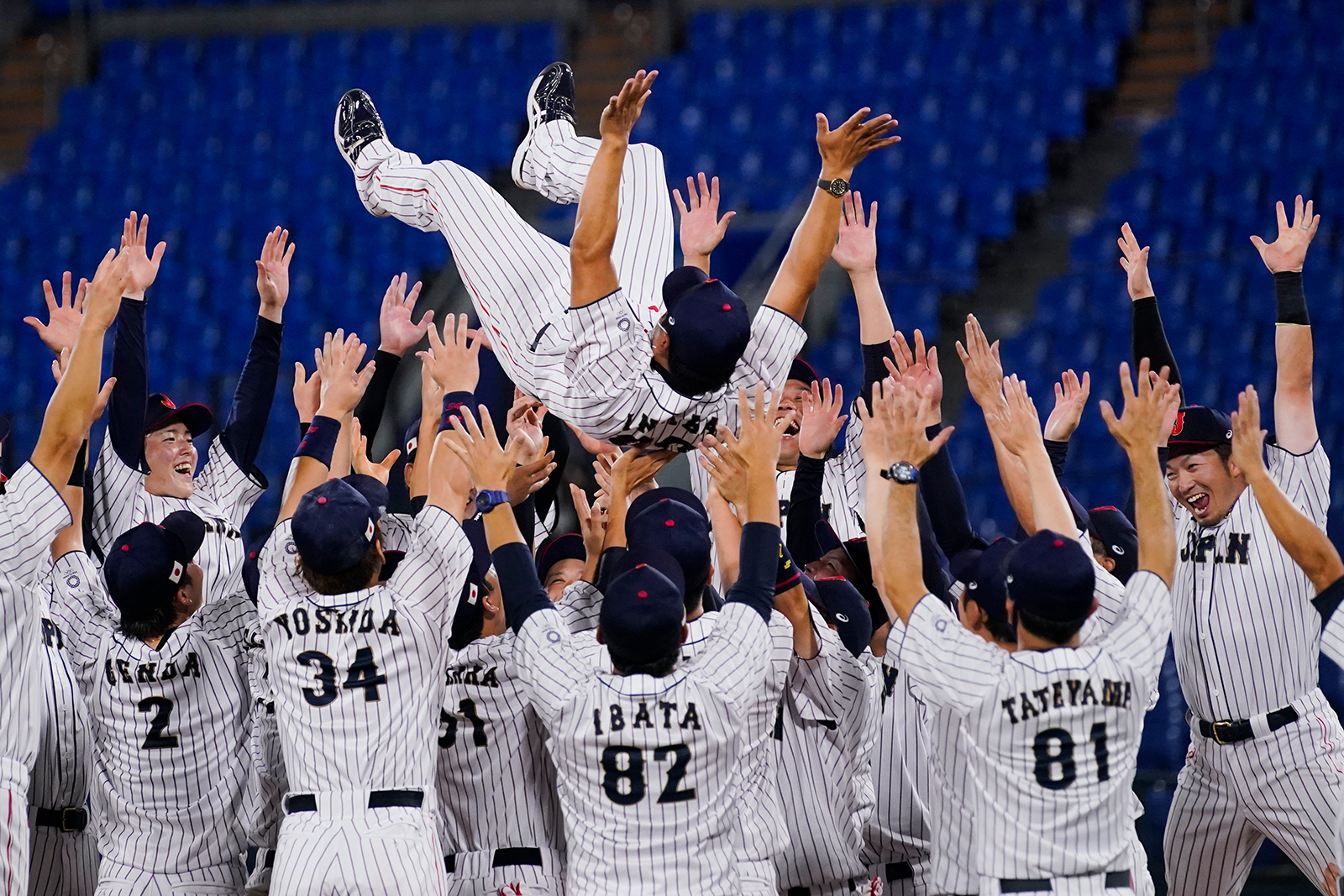 Team Japan celebrate with their manager Atsunori Inaba after the gold medal baseball game against the United States at the 2020 Summer Olympics, on August 7,  in Yokohama, Japan.