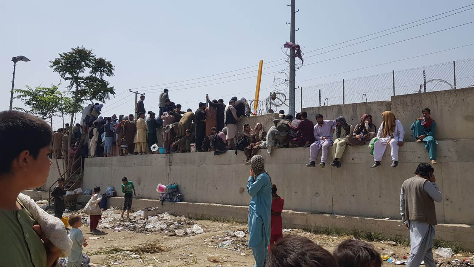 People wait outside Hamid Karzai International Airport in Kabul, Afghanistan, on August 23.