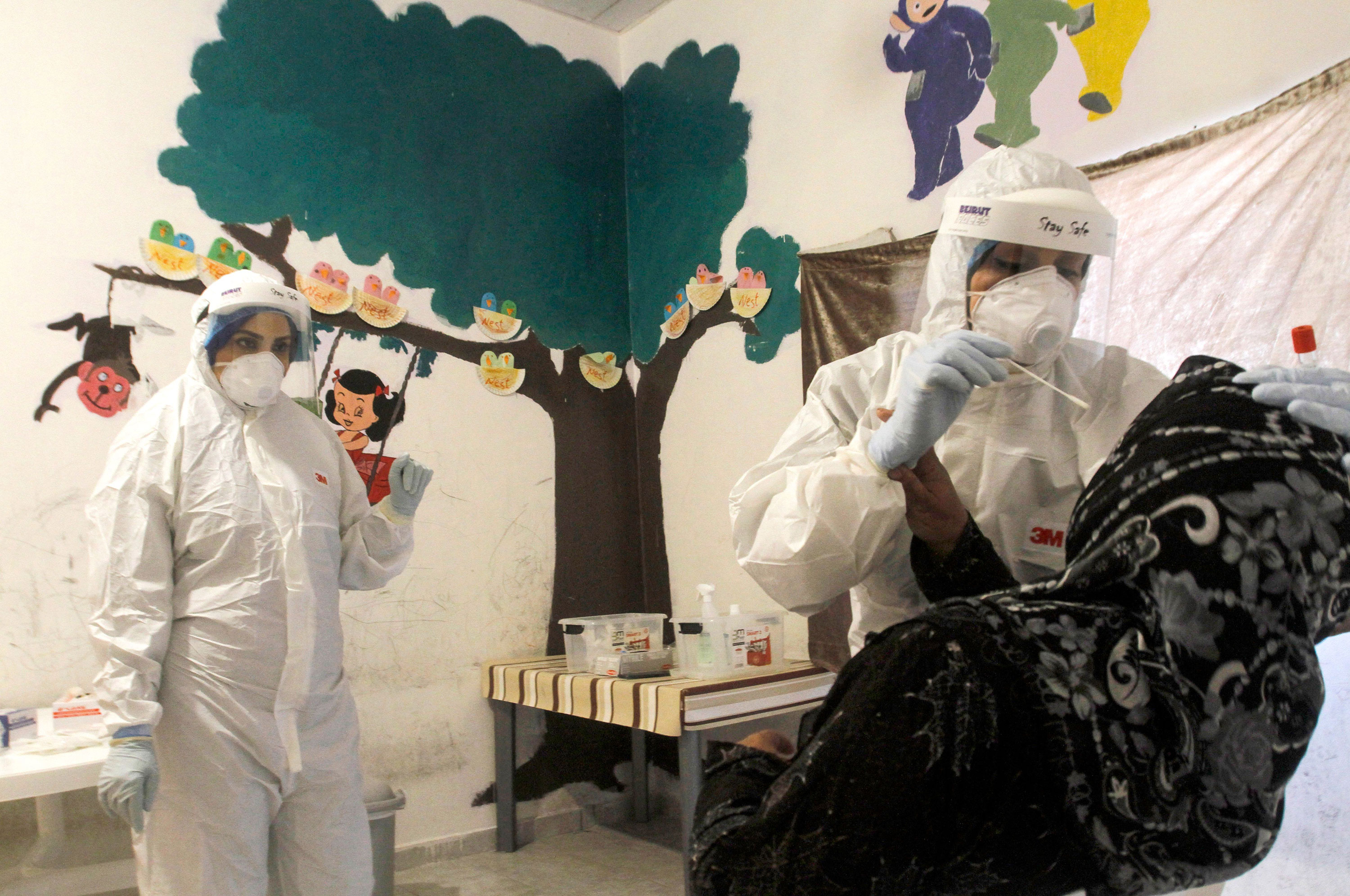 Workers administer a coronavirus test on May 28 in Sidon, Lebanon.