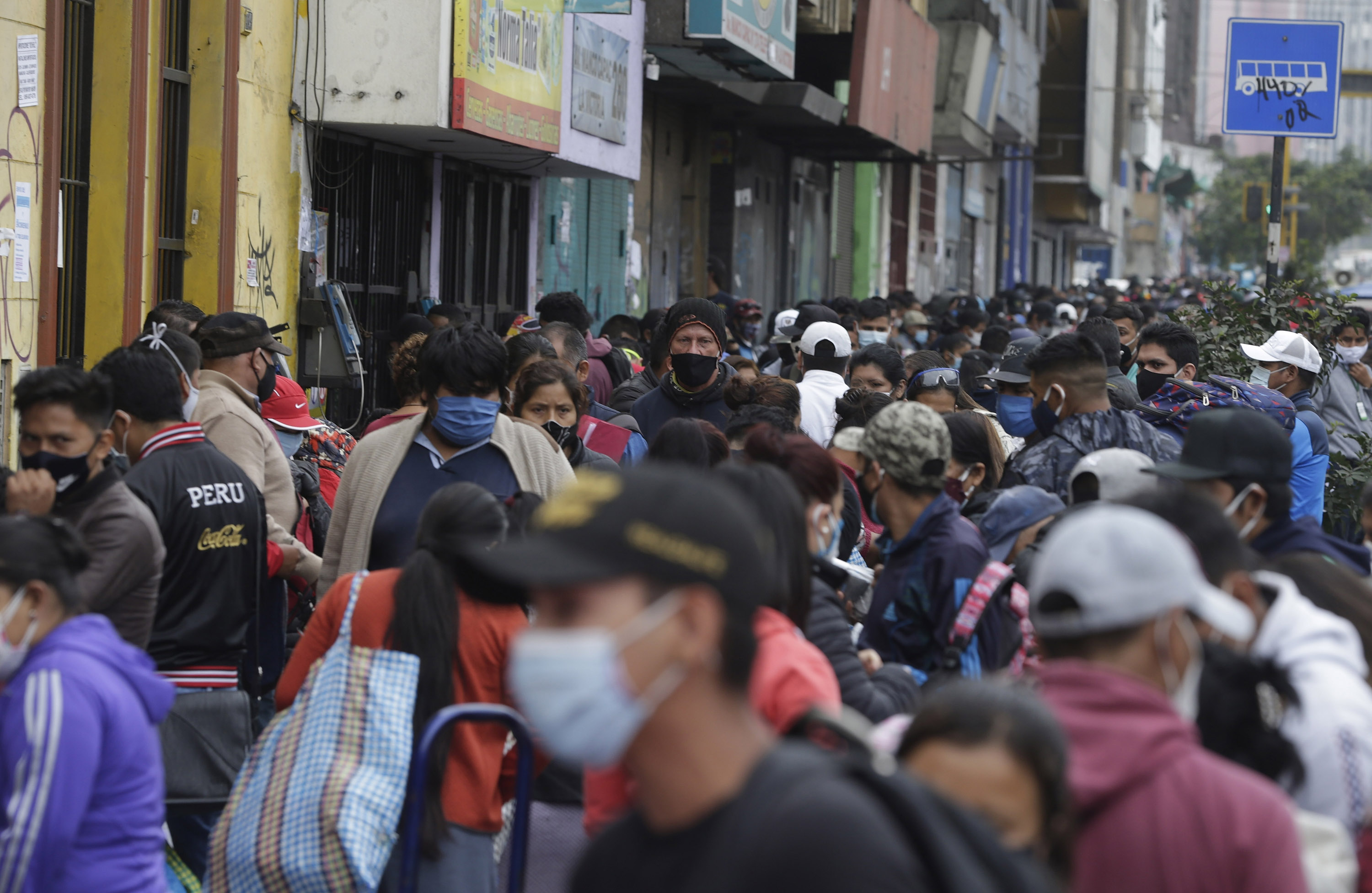 Streets vendors and shoppers wear masks during the coronavirus global pandemic in Lima, Peru, on Monday, June 8.