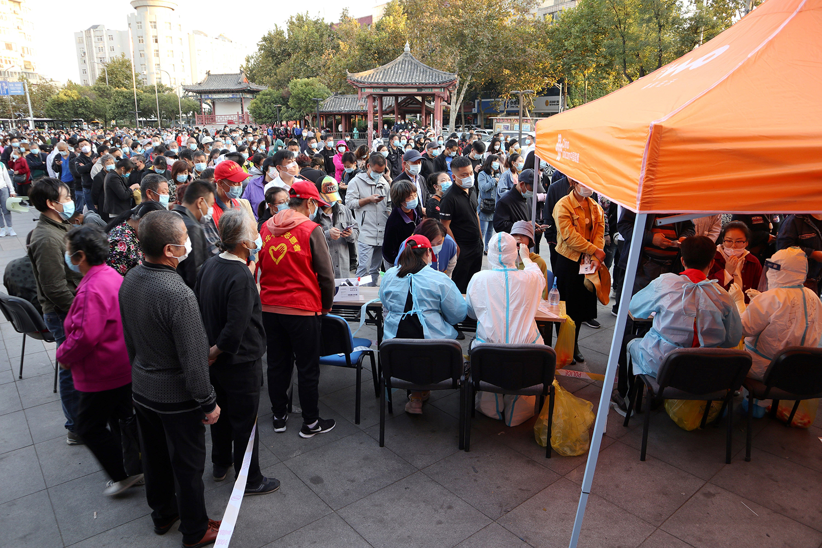 Residents line up to be tested for Covid-19, as part of a mass testing program following a new coronavirus outbreak in Qingdao, in China's eastern Shandong province, on October 12.